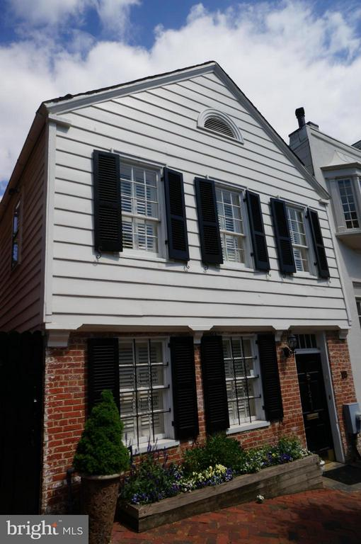 Charming 1803 historic TH in Georgetown! Updated & well maintained. 2 Full Kitchens, 3 BRs, 2.5 baths, Den in LL is being used as a BR. Walk-out LL. Flagstone patio, 200 yr old & Cherry Wood Floors throughout. Attic w/ closets for storage. 2 yr Copper Roof.  Beautiful large garden enclosed w/tall brick walls-great place for entertainment! tons of shops, restaurants & nightlife.