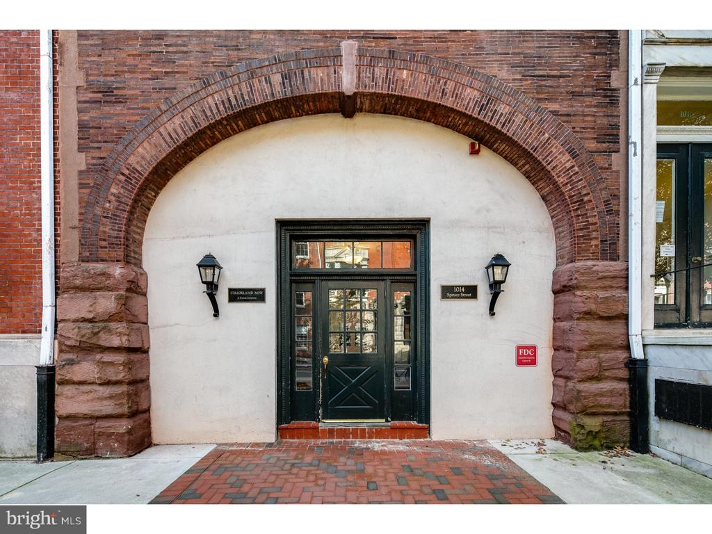 Strickland Row at its best!  This unit is in amazing condition! Enter into the spacious living room which has lots of natural light.  Hardwood floors throughout the unit! The living room also features a wood burning fireplace! Unit is on the first and 2nd floors of the building. No basement rooms!  Kitchen is very upgraded with solid maple cabinets, gorgeous Caesarstone countertops, stainless appliances including Fisher & Paykel refrigerator and dishwasher drawers, Kitchen-Aid gas range and built in GE microwave. Upstairs is a very nice upgraded bathroom.  Both bedrooms have excellent closet space and there are also numerous additional closet spaces throughout the unit. The unit has its own washer and dryer.   Strickland Row features a lovely courtyard with a large heated swimming pool, BBP in side courtyards, and a common roof deck with skyline views.  Condo fee includes hot water, heat, AC, gas, and access to swimming pool and two courtyards!  Only additional monthly cost is electric.  Amazing central Washington West location near Jefferson Hospital, Pennsylvania Hospital, coffee shop, restaurants, Whole foods and everything center city has to offer!  Walk Score of 99!   AKA 1008-20 Spruce Street, Unit 1010D