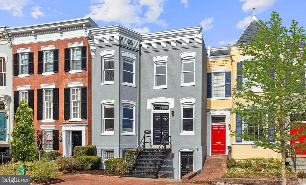 Back on Market. Elegant Federal style home in the East Village of Georgetown. Filled w/classic historic charm, yet modern.  Meticulously maintained & renovated, 3 levels w/ ~5,000 SF of spacious living. 5BR/4.5BA, high ceilings, wood burning fireplaces, beautiful hrdw floors, skylights. Large garden and terrace. 1BR rental unit w/ CofO &separate entrance + in-law suite. Parking lease paid 1 yr.