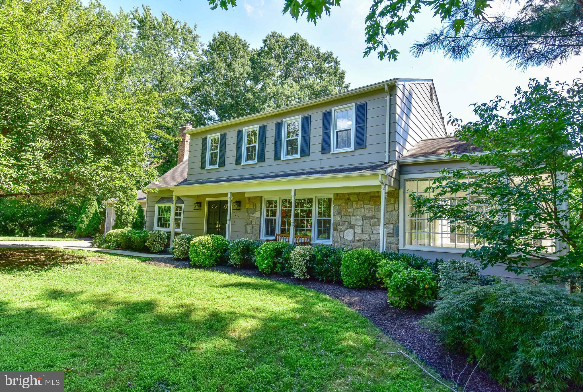 Open Sun 12-2pm! Wow - GREAT PRICE! Don't miss out! Beautiful & spacious 5BR, 3.5BA colonial.Elegant wood floors. Flooded w natural light!  KIT w SS appliances, new granite counters & cheerful breakfast room. Spacious LR. Stone-floored sunroom. FR w wood-burning FP.  Sumptuous freshly painted MBR w sitting rm.Fully fin bsmt. Expansive deck off addl sunrm + fenced yard.2car gar.