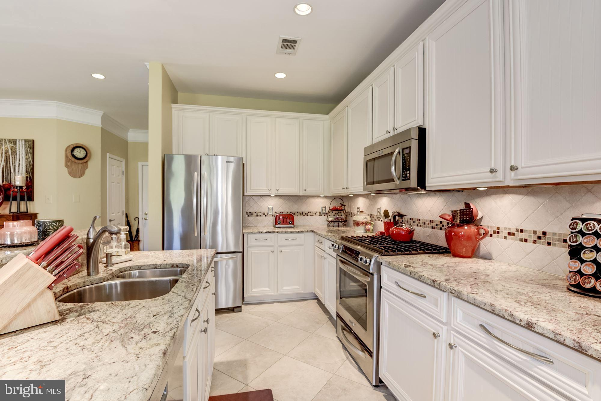 $40K+ in upgrades-nothing like it ever before on the market! Water view from every rm! Beautifully renovated w/ open floor plan, gourmet kitchen, ss appl, exotic granite, porcelain wood-grain tile, updated baths, cust closets, gas fpl. New HVAC (2017). En suite master w/ walk-in closet & safe.  Amenities incl pool, club house, fitness & more! Amazing location - walk to tons of shops & restaurants.