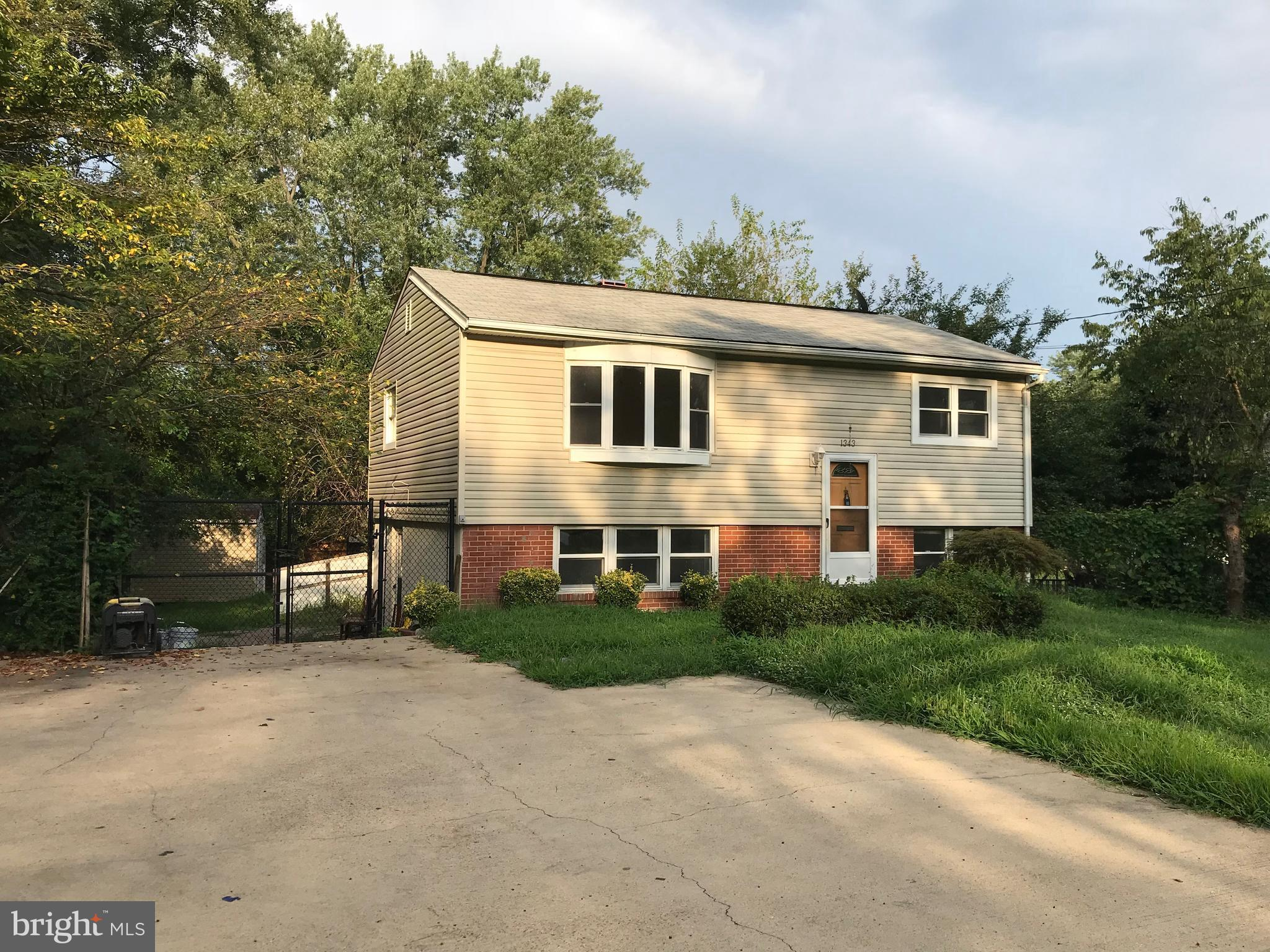 Beautiful single family house with nice backyard.Four bedrooms with two full baths. Open floor plan in great location. New paint through out the house. New carpet, hardwood floor on main level. All brand new appliances and granite counter top.Please call for prior to showing. Sentrilock front door. Vacant.