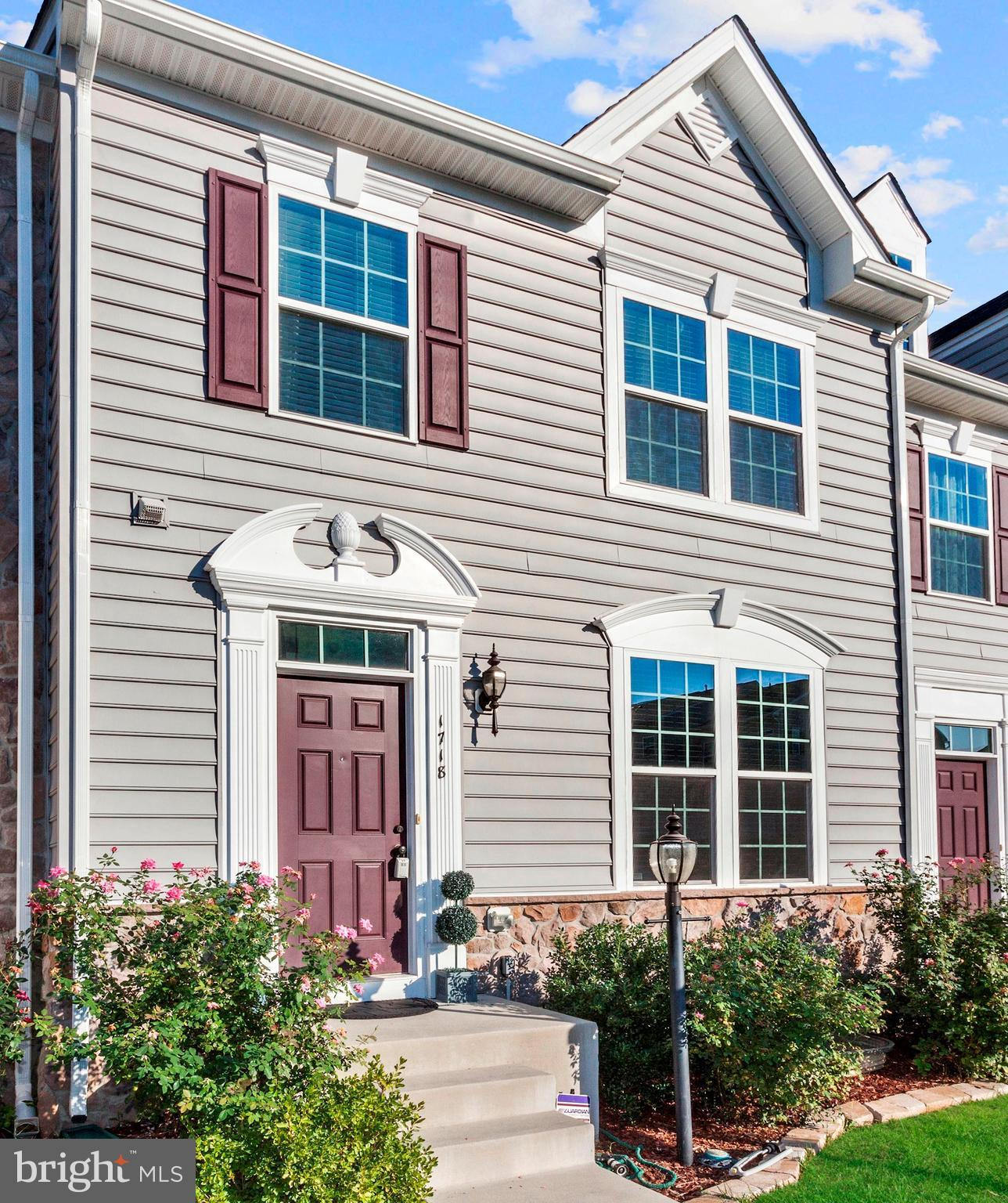 Stunning 4 bed town home loaded with gleaming hardwood floors, crown/chair molding, upgraded kitchen with granite. island, ss appliances, finished walkout basement with wet bar, stamped concrete patio, deck and backs to trees.