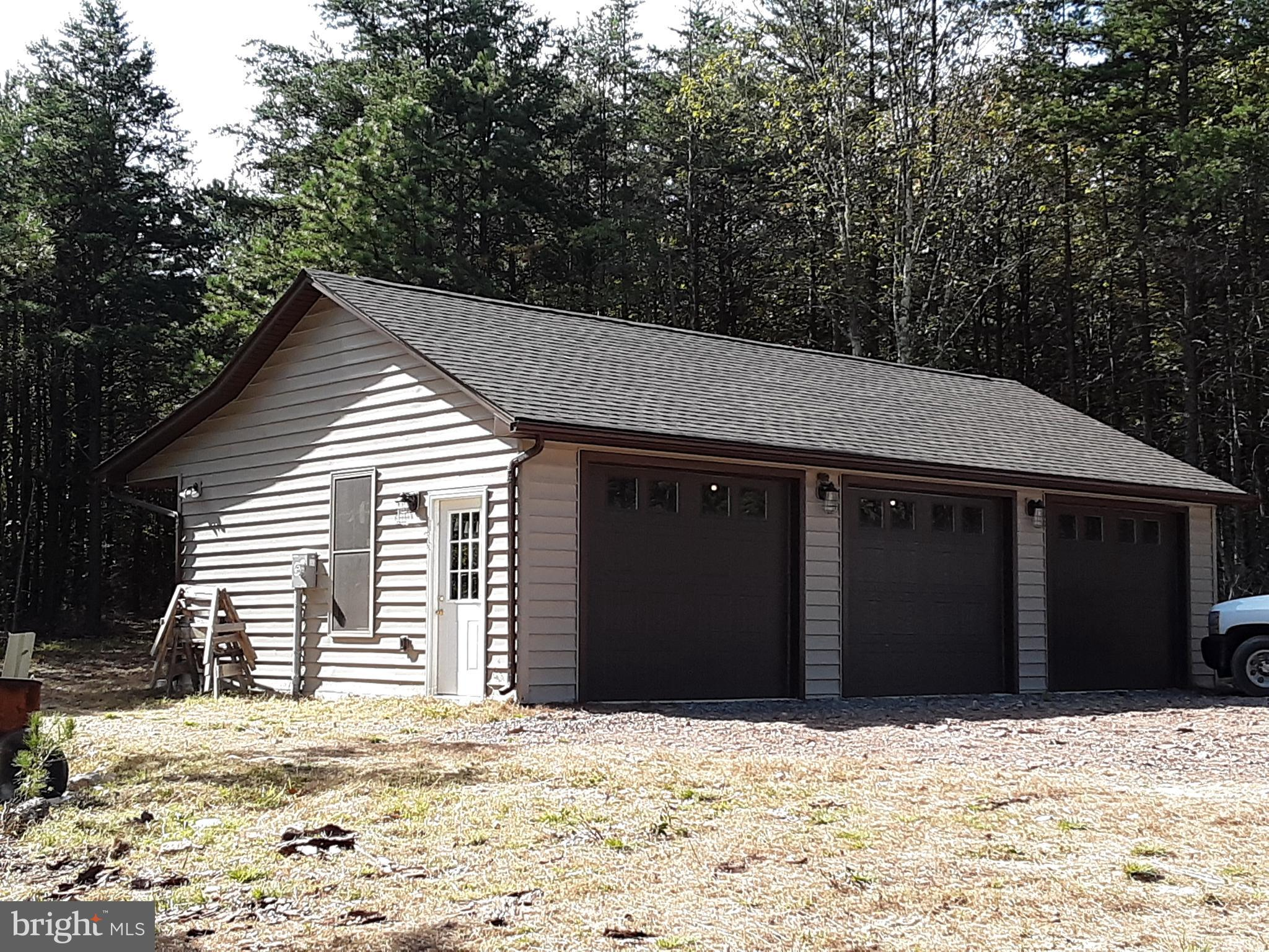 LOOKING TO OWN A PIECE OF HEAVEN THEN CHECK OUT THIS 24.745 PRIVATE ACRES WITH MILLION $$$ VIEWS . 3 BED 2.5 BATH CAPE COD 2 CAR GARAGE , FIREPLACE & WOOD STOVE FOUNDATION IS IN , 3 CAR DETACHED  GARAGE IS W/ ROUGH IN PLUMBING. BRING THE FISHING POLES FOR YOUR OWN PRIVATE POND. TRAILS WILDLIFE GALORE. BUY AS-IS FOR $179,900 OR THE BUILDER WILL FINISH. $379,900 QUALITY WEEKEND OR YEAR ROUND LIVING.