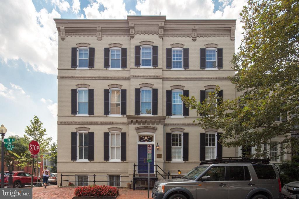 Filled with light, this stunning, spacious condo is in the heart of coveted Georgetown. Rich hardwoods sweep through gracious living room, centered around a fireplace & entire wall of built-in bookshelves. Expansive bedroom boasts renovated en-suite bath & large closet with built-ins. Graphic wallpaper sets chic tone in stunning kitchen with modern shelving, granite & stainless steel. Relax on your private terrace under a soaring Magnolia tree. Picnic at nearby waterfront park, stroll through Dumbarton Oaks gardens & hike C&O trails. Near university, Safeway & Trader Joe's.