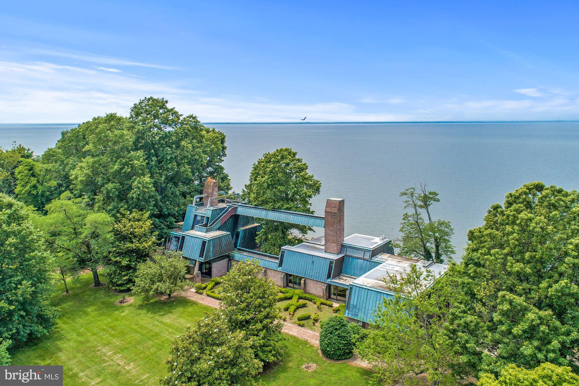 NEW PRICE! 200K PRICE ADJUSTMENT! Amazing opportunity. Located on the Chesapeake Bay, Rock Hall Stud is a 240 acre property featuring a 12,520 SF unique, waterfront main residence built in 1986, swimming pool, private beach, stud farm with facilities, and beautiful private and sub-dividable acreage. An outside observation deck that spans the entire length of the home's copper roof boasts panoramic views of Bay Bridge and Baltimore skyline.