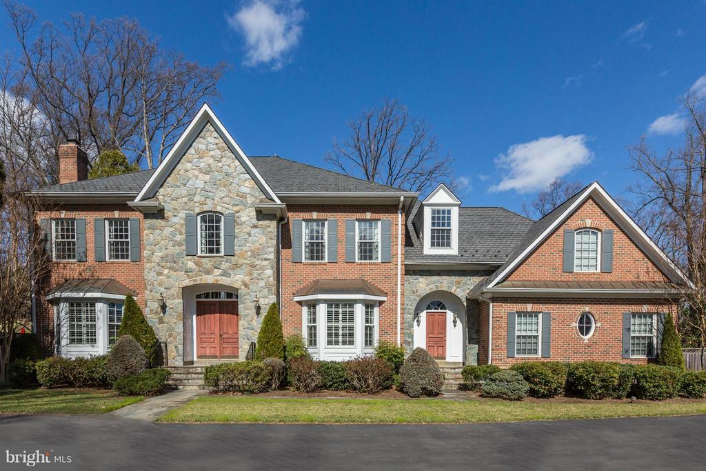 EXQUISITE STONE AND BRICK COLONIALEstate Setting on a 1+ Acre LotWelcome to this fabulous stone-and-brick colonial in a magnificent estate setting in the highly desirable Burning Tree community. A traditional floor plan features well-proportioned sun-filled rooms ideal for full-scale entertaining as well as comfortable family living. From the dramatic two-story center hall foyer, to the exquisite gourmet kitchen with adjoining breakfast room, to thewonderful master bedroom suite with sitting room, no detail has been compromised in presenting a home of distinction. Three finished levels are enhanced with custom mouldings, wet bars, four fireplaces, and include an exercise room, media room, and large recreation/game room with walk-out access to the gorgeous grounds, The terrific backyard is framed with mature trees and boasts a heated swimming pool, stone patio, gazebo, koi pond,expansive Brazilian hardwood deck, and extensive  professional landscaping. Ideally located in close-in Bethesda, the home is convenient to shopping, restaurants, public parks, Route 270, the Capital Beltway, three major airports, and the vibrancy of both downtown Bethesda and Washington, D C.