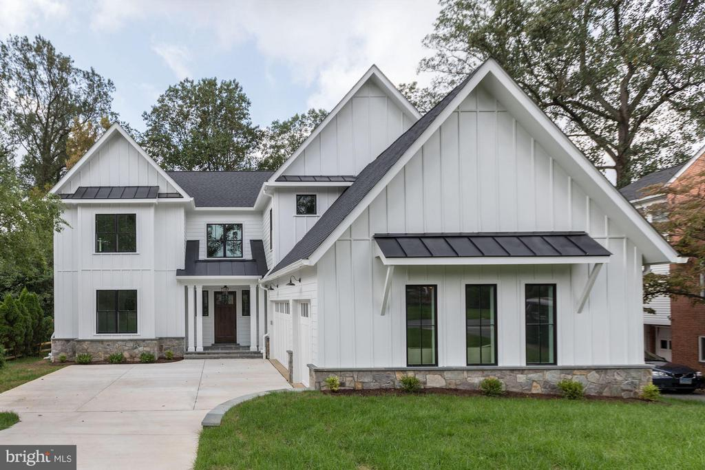 Modern farmhouse-style NEW custom home w/open flrplan! Located on pool-sized lot, the 4-level home (over 8600sf!) is in the Whitman HS cluster, just 1.5miles to downtown Bethesda. You'll be top chef in this kitchen w/6-burner Wolf; Sub-Zero frig, 2 DWs; gorgeous lighting thruout. 2-sided gas FP in great & pub rooms AND 1 on screened in porch! MBR suite w/stunning carrara marble bath. 3 car Garage