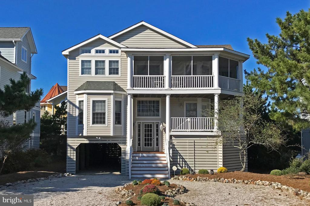 Located within a desirable North Bethany gated community, one lot off the beach, offering ocean and rear bay views. Spacious inverted floorplan, inviting open great room and plenty of outdoor living space and decks. Positioned on a partially wooded lot with mature pine trees and only steps to a private life-guarded beach. This thoughtfully designed coastal home offers vaulted ceilings, gourmet kitchen, light filled great room, built-in cabinets, spacious private master suite and spectacular ocean views from a third-floor screened in deck. The property has been well maintained and is offered fully furnished. A circular driveway and covered parking offers spaces for over eight vehicles. Excellent rental investment and perfect design for entertaining or relaxing with family. Enjoy your summers on a pristine, uncrowded private beach within the community of Breakwater Beach. Make your beach dreams into unforgettable memories!