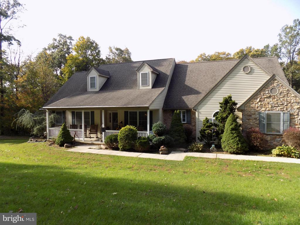 Custom one owner 4 bedroom Rancher with full daylight basement perfect for in-law quarters. 2.2 acres with 1 yr old 24x34 barn w/ 2 stalks, tack rm, water & elec. Fenced pasture, partial wooded lot. Home has 4118 SF of finished area. Spacious eat-in kitchen w/ Oak raised panel cabinets, SS appliances & breakfast island. LR w/ HW floors, skylights & stone gas FP. MBR w/ 13x10 bath w/ whirlpool tub, shower, dbl vanity & WIC. Large 40x36 finished LL w/ 10x10 kit/bar, full bath, 12x12 BR, storage areas, pellet stove & kitchenette. Total 5BR, 3 full baths, deck, patio & 7x30 covered front porch. 12x20 utility bldg. Gas forced air heat & central A/C. Lovely country location yet minutes to Rt. 222 & turnpike. A must-see property!
