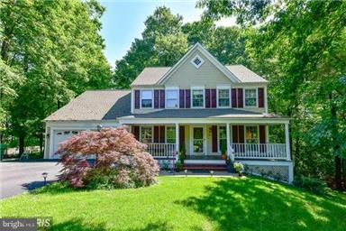 Beautiful Victorian Style Colonial w/huge Country Porch w/Swing ! Culdesac loc on Half Acre Wooded Lot in Fab Lake Ridge ! Upgraded Kitchen w/Granite & SS Appl ! Fin Walk Out LL w/3rd Bath & Rec Rm & Hobby Rm & Cedar Closet ! 8x6 Storage Under Custom 3 Lvl Deck ! 2 Car Garage ! You will LOVE it !!!