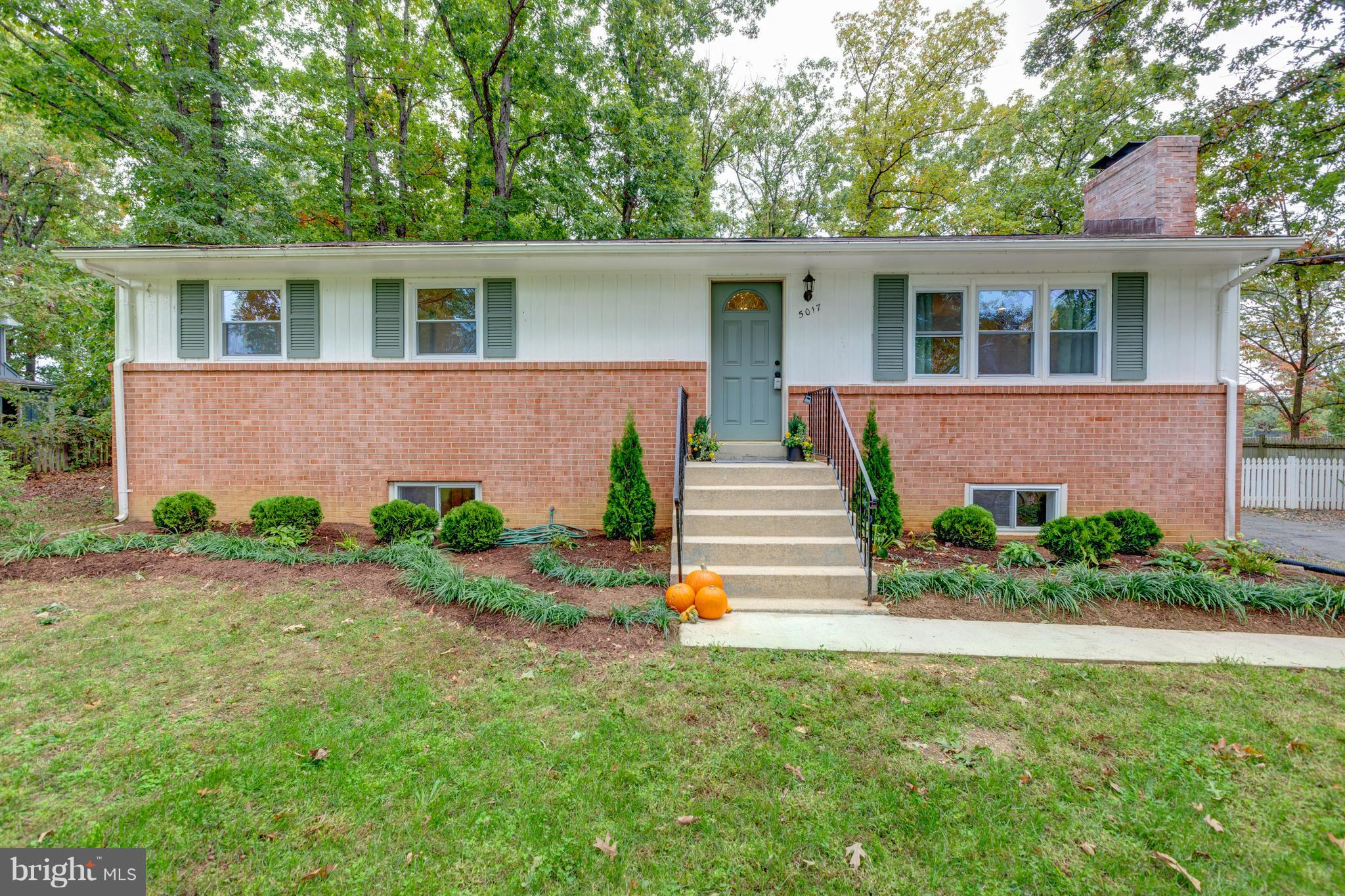 Live inside the beltway in this renovated 5 bedroom home on 1/2 acre fenced lot and no HOA. New Kitchen with SS appliances. Upgraded bathrooms. Large Master on the main floor with connected bath. Fireplace with custom built ins.  Wood floors on the main level. Finished basement with den, rec room and newly added laundry room. Wooded mature lot in quiet neighborhood. Close to all commuter routes to Amazon HQ and DC.