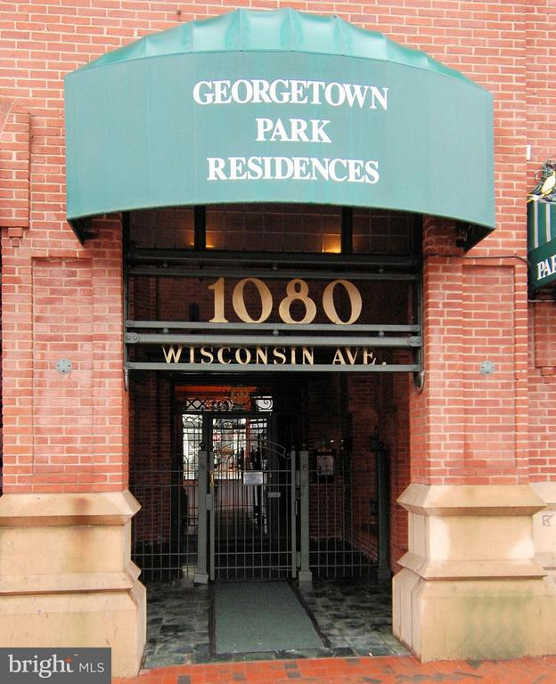 The best of Georgetown Park! Renovated with new washer, dryer. 1400+ sq feet with huge balcony on the canal. 2 BD/2BA with new carpet, refinished floors, freshly painted,  custom lighting and woodwork, open floor plan and floor to ceiling windows. Garage Parking  & pool.  Absolutely Fabulous!