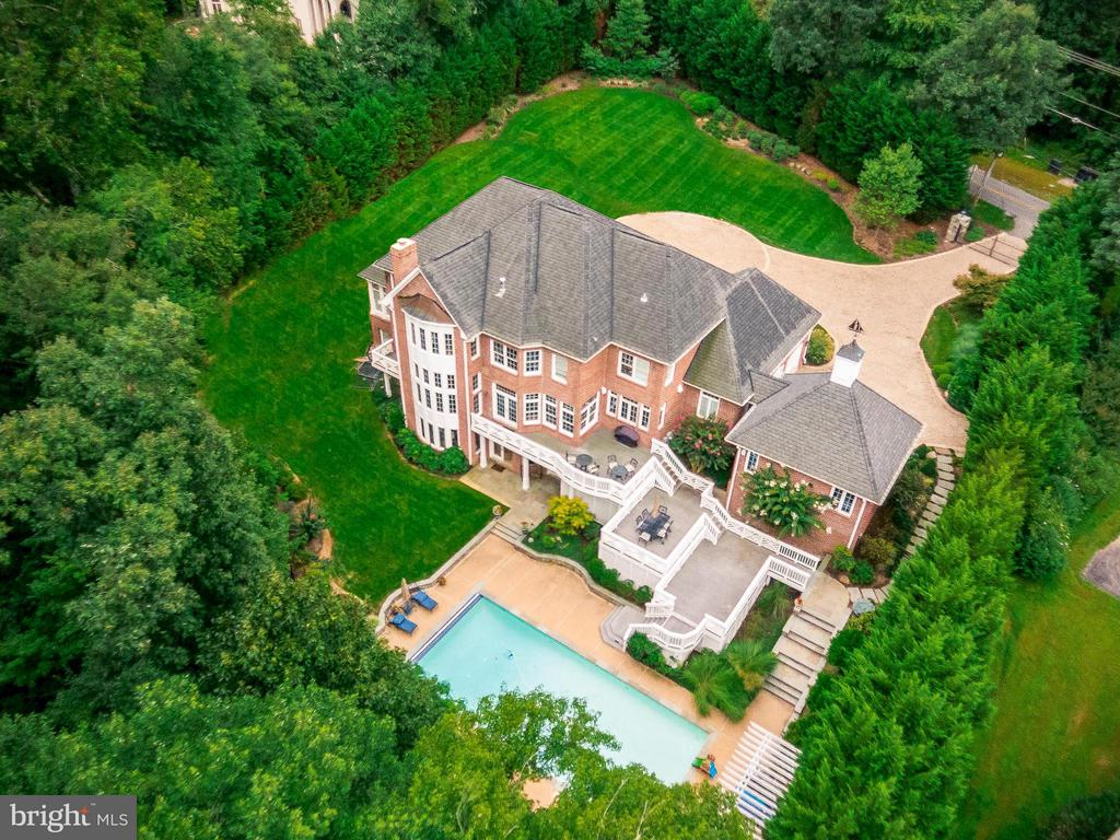 OPEN HOUSE SUN, 5/19, 1 - 4pm. Minutes from Tysons Corner, Metro, Dulles Airport, Commuter Routes & McLean Shopping, Dining and Entertainment. Private, Gated, Luxury Estate on 2.4 Acres. Gated Access, Luxury Lighted, Stone Circular Drive with 4 Car Garage. Extensive Hardscape, Exterior Lighting, Landscaping Front and Back, Fully Fenced. Multi-Level Decking, Stone Patios and Walkways, Large Pool and Cabana, Pergolas, Backs to Woods. All Brick, Custom Estate Home Extensively Expanded and Renovated Throughout. Exquisitely Appointed with Luxury Updates and Open Floorplan for Gracious Living Inside and Out. Spectacular Foyer Entry Flanked by Formal Living and Dining Rooms, Grand Solarium and Private Office with Balcony. Spacious Gourmet Kitchen with Professional Viking, Boche, SubZero Appliances Adjoins Sunny Breakfast Room with Deck Access. Soaring Family Room with Grand Curved Floor To Ceiling Windows and Raised Stone Hearth. Upper Level Gallery Accessed by Front and Back Stairways with Grand Master Suite and 4 Additional En Suite Bedrooms. Huge Walk In Attic/Storage Room. Fantastic Lower Level with Large Family Room with Raised Wood Burning Stone Hearth and Coffered Ceiling, Full Loaded Wet Bar, Game Room, Gym and 2 Additonal Bedrooms and Full Bathrooms (Perfect In Law  or Au Pair Suite). Dual French Doors Walk Out to Extensive Patio / Pool / Cabana Area. 20x40 Heated Pool, Hot Tub, Cabana / Pool House. Beautifully Landscaped, Lighted Grounds. Spectacular Secluded Great Falls Address with McLean Convenience! Just 3.4 Miles to Tysons Corner & Metros. The One!