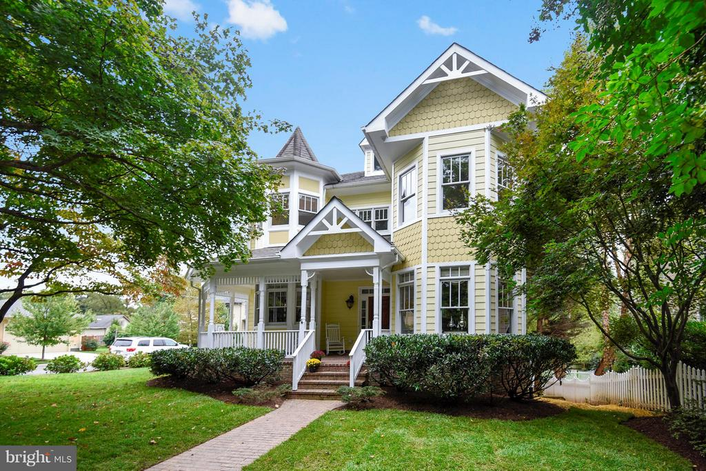 This charming Victorian with wrap-around front porch is situated on a desirable corner lot in the sought-after North Arlington neighborhood of Woodmont, just one light to DC and within walking distance of bike trails and parks. With over 5,700 square feet on four levels, this home boasts 5 bedrooms and 5.5 bathrooms. The main level features Brazilian cherry floors, custom window treatments, an expansive living room, a study, separate dining room, and a gourmet kitchen with butler's pantry. The walk-out lower level provides easy access to the garage and side yard and includes a recreation room, den, full bath, and guest bedroom. The upper level includes a master bedroom suite (with sitting room and luxury bath), three additional generously-sized bedrooms, and conveniently-situated laundry room. The finished loft with full bath makes an excellent au pair suite, playroom, or hobby space. Other features include a whole-house backup generator & security system.