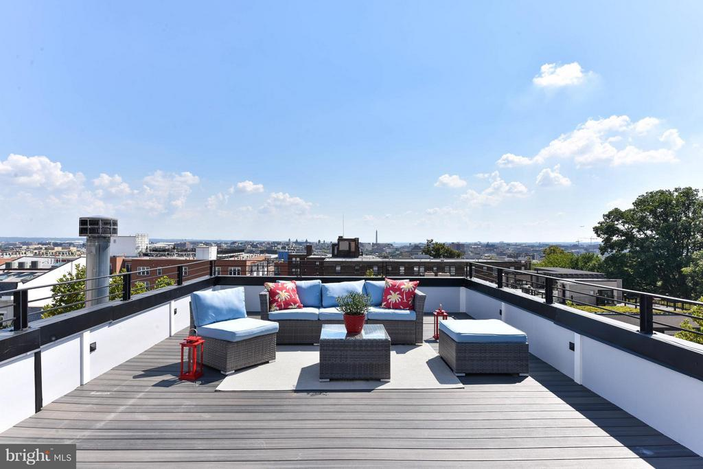 New Price & Open Sunday from 2-4 pm! LUXURY PENTHOUSE UNIT with amazing view! 3BR/3.5BA- live in the middle of U St, 14th St & Meridian Hill Park!  Three levels of living with a PRIVATE ROOF DECK and contemporary finishes throughout. Living area with floor to ceiling windows & oak flooring in French gray. Sleek kitchen with table space & white marble counters. Luxe owner's suite with ensuite BA & double vanities.  The roof deck is incredible- with DC city views and an expansive space to entertain, lounge, and more! Secure parking completes this amazing opportunity!