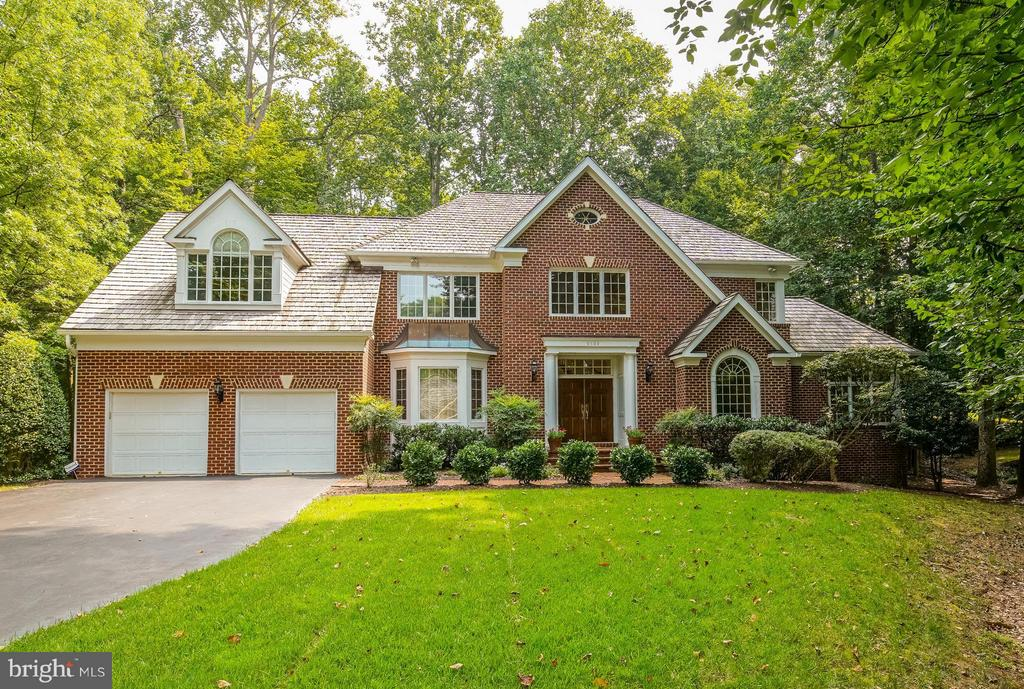 Bright & airy, all-brick home on landscaped 1/2 acre lot. Over 6500 sf on 3 fin levels incl glorious sun room w/3 sides of glass. You'll love the main level cherry study w/built-ins, updated gourmet kit open to fam rm w/stone fireplace & access to deck & yard. Owners Suite w/sitting rm & marble bath. Updated systems & generator! Easy commute to downtown DC & N VA!