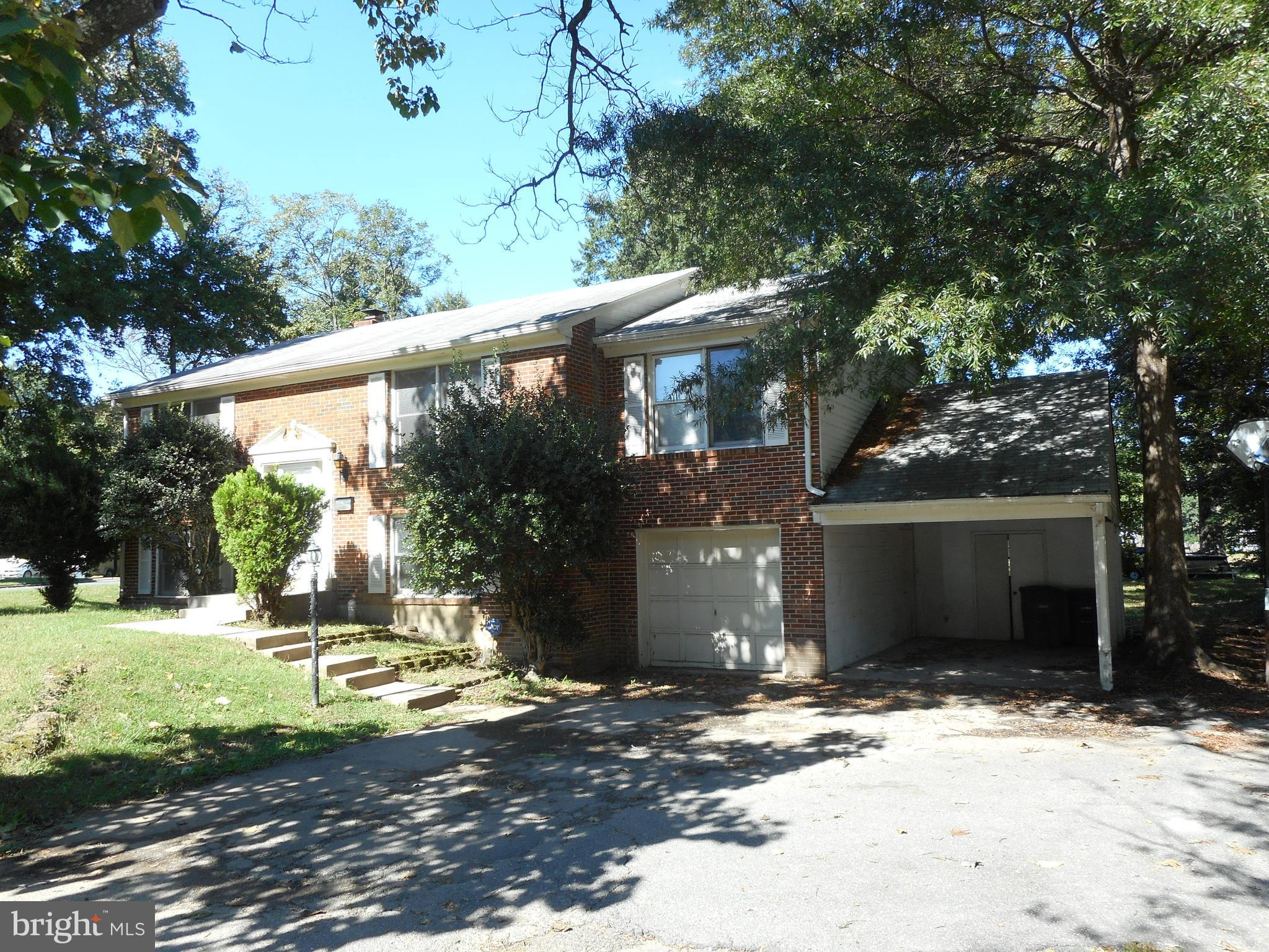 Single Family Home on a half acre corner level lot!!! This 5 BR 3 full bath has been freshly painted and ready for tenants. Large deck on the back overlooks the tire swing in the back yard. Built in cabinets in the dining room and full size washer/dryer. Great location! Close to local commuter routes, shopping and schools. Walking distance to Lee District Park.