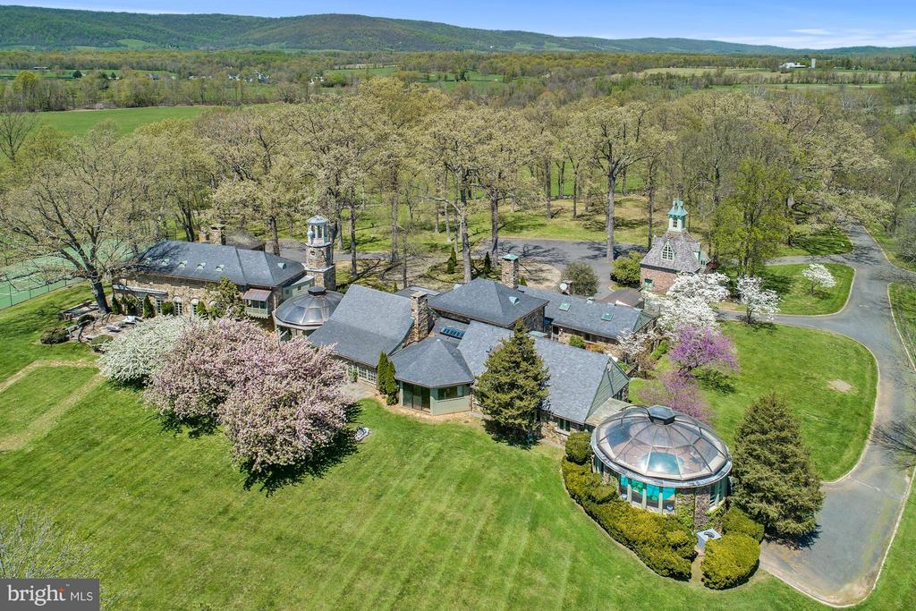 Incomparable 14,000 square foot estate set into 57 glorious acres in Upperville's Hunt Country. Grand entertaining spaces include the ballroom that flows onto the terrace via massive French doors, banquet-sized dining room, & commercial-grade kitchen. Intimate spaces include the hunt room, club room & breakfast room. Renovated 3-bedroom guest house plus fenced paddocks, run-in & 10-stall barn.