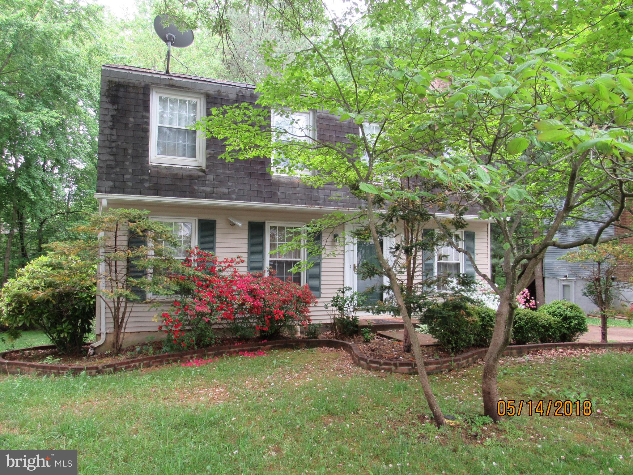 Fresh neutral paint & new carpet throughout in this lovely 4 BR, 2 full and 2 half bath colonial on backing to woods for loads of privacy! Hardwoods, formal LR, DR w/chair rail. Upgraded eat in kitchen with granite opens to screened porch & deck leading to yard & tree view! Spacious FR w/cozy FP. MB w/full bath. Loads of storage space! Walk out LL has rec rm! Minutes to VRE, shopping, golf, parks!