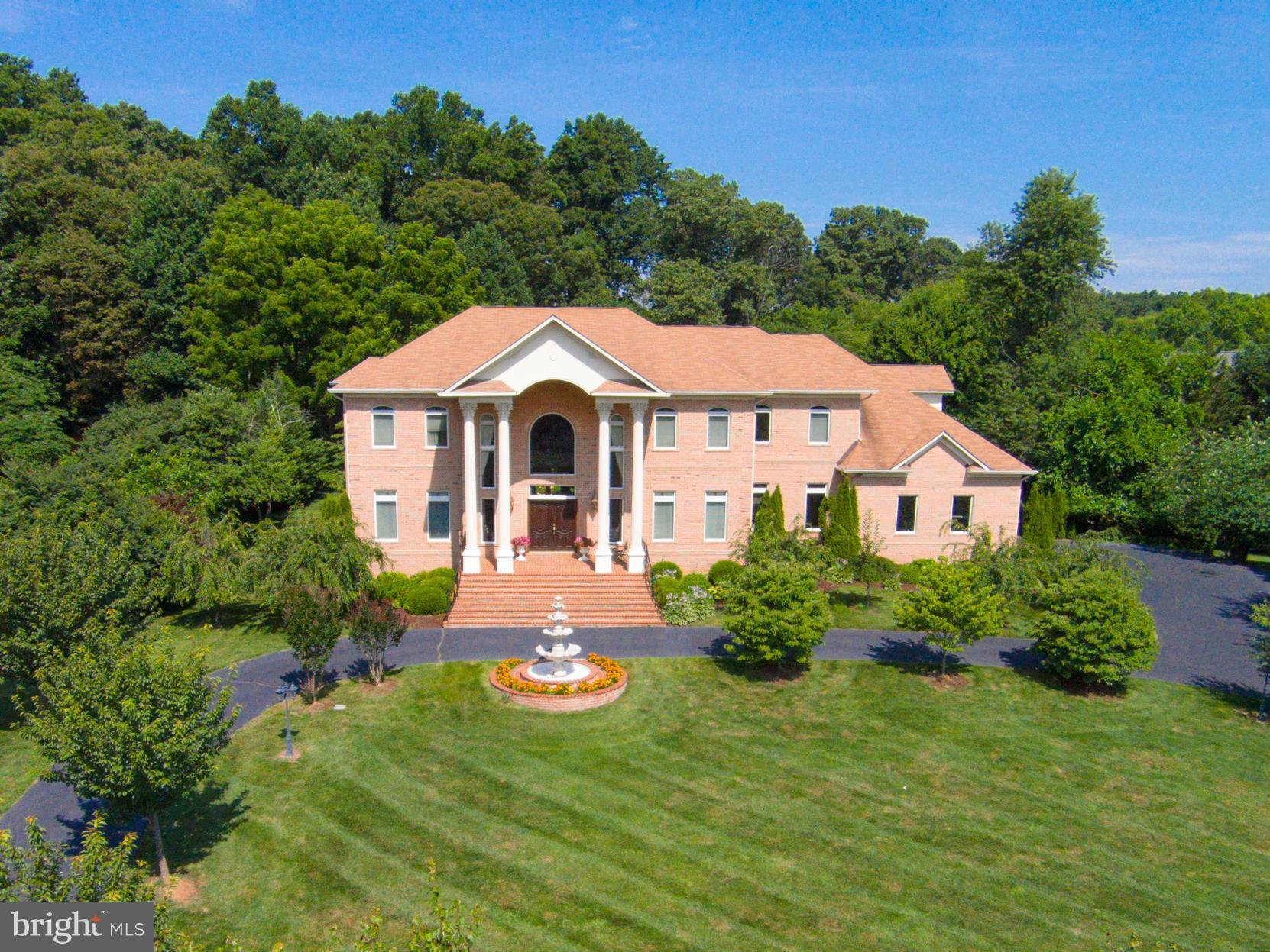 MOTIVATED SELLERS*** ALL BRICK ONE-OF-A-KIND CUSTOM MASTERPIECE, OFFERING ABOUT 9,000 SF & AN OPEN FLRPLAN* GRACIOUS CIRCULAR DRIVE, 3 CAR GARAGE*EMBASSY SIZE ROOMS, IDEAL FOR PARTIES*6 BR, 6.5 BATHS, INCLUDING MAIN LVL GUEST SUITE* ELEVATOR  TO ALL 3 LVLS*4 GAS FP, INCL MBR*ALL BR'S OFFER BATH ENSUITE* BREATHTAKING LANDSCAPING*5 MINS TO I-66, VIENNA METRO*NO EXPENSE HAS BEEN SPARED!