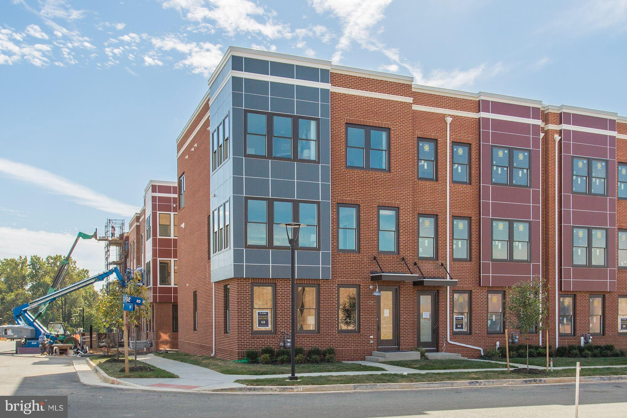 READY TO MOVE IN! BEAUTIFUL 4-LEVEL TOWNHOMES WITH ROOFTOP TERRACE AND FIREPLACE. FACING THE LIBERTY GREEN.