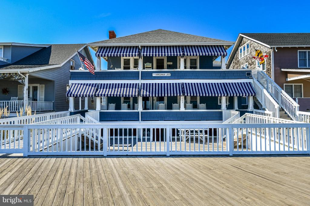 Opportunities abound in this Iconic Boardwalk Residential Property! 10th St on the Boardwalk. Currently 3 Apartments - Boardwalk level one 2 Bed/1Bath and one 3 Bed/2 Bath. These units generated over $70K in income Summer 2018.  An additional 4 Bed/2 Bath Unit on the top floor was not a rental.  Full DRY basement below.  Property is Deed Restricted to Residential Use only.  One of the few Residential Blocks.  Separate Parking lot included in sale.   Tax Record 10-035694.  9+ spaces assigned to Virginia Lee.