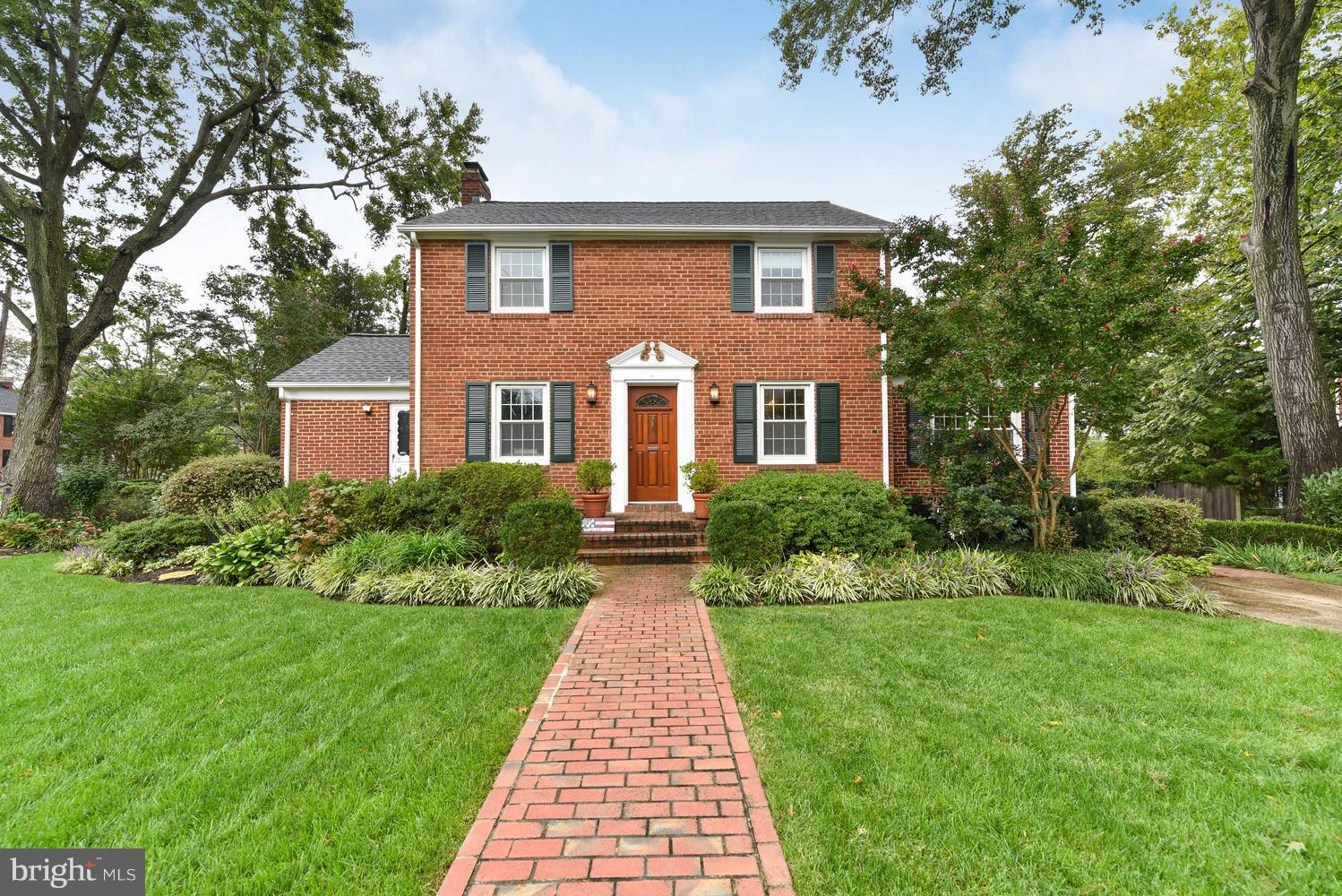Make yourself at home in this charming bygone era Colonial near historic Old Town! Built on a large corner lot & enhanced w/prof. landscaping. Walk-in & admire classic features; HWF, chair rail, WBFP & arched doorways. Formal rooms encourage entertaining. Sunroom=enjoyment year-round+offers brick accent wall. Convenience of ML BR+BA. Updated KIT. LL is a blank canvas. Off/St parking&close to metro