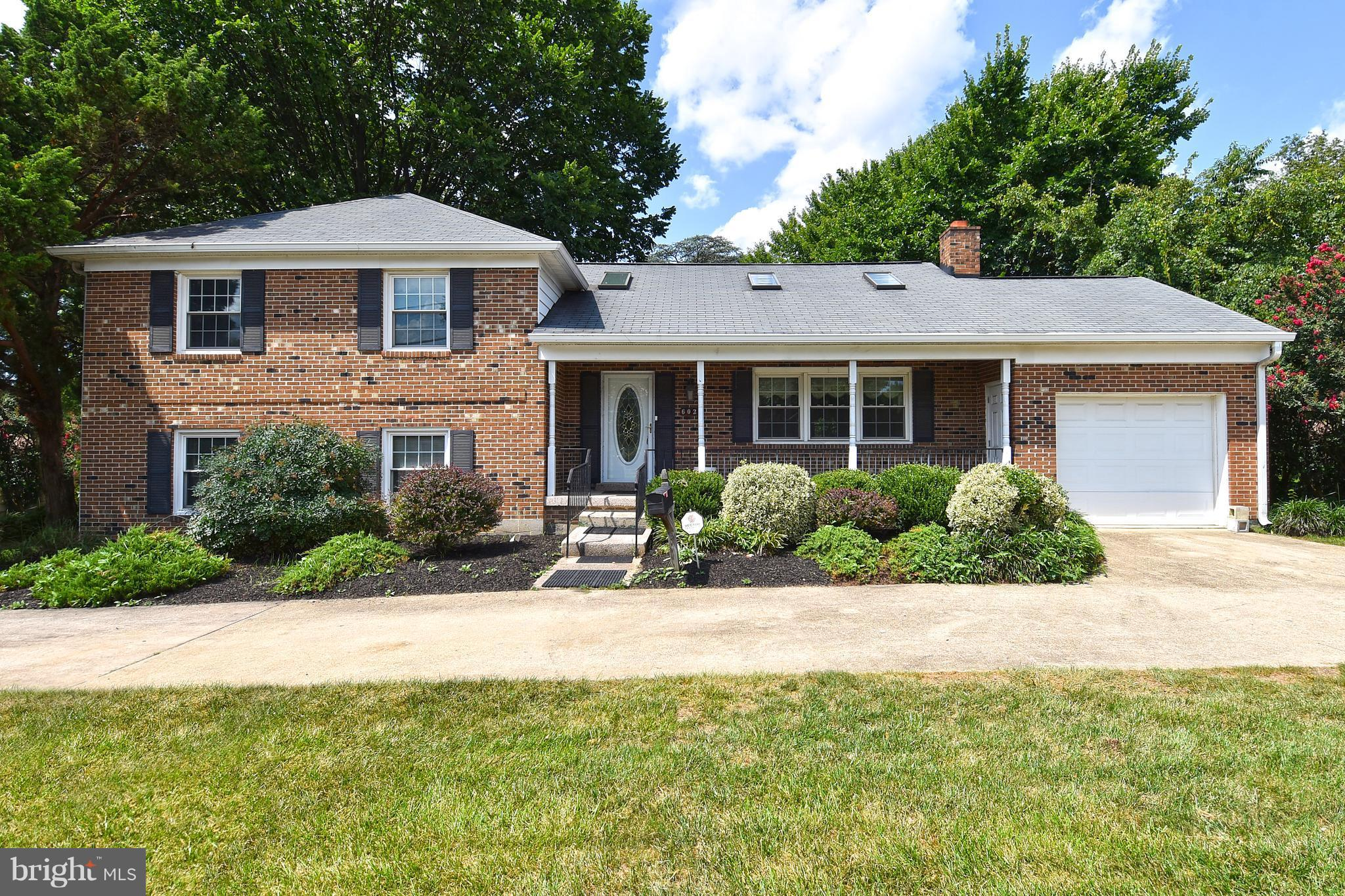 PRICE REDUCED ON THIS Large, Beautiful, 4 Lvl. w/5BR & 3BA. Beautiful Hardwood Floors, Freshly painted,  New Wall to Wall Carpet. Close To Two Metro Stops; Circular Drive & 1 Car Gar. 2 FP's; Large Eat-In Kitchen w/Extra Cabinets; 2 Extra Storage Rooms; Large, Private Back Yard; Newer Thermal Windows; Alarm System; Close To Schools & Major Shopping Center.  Great Commute To All Areas. Ready To Move Into & Start School!