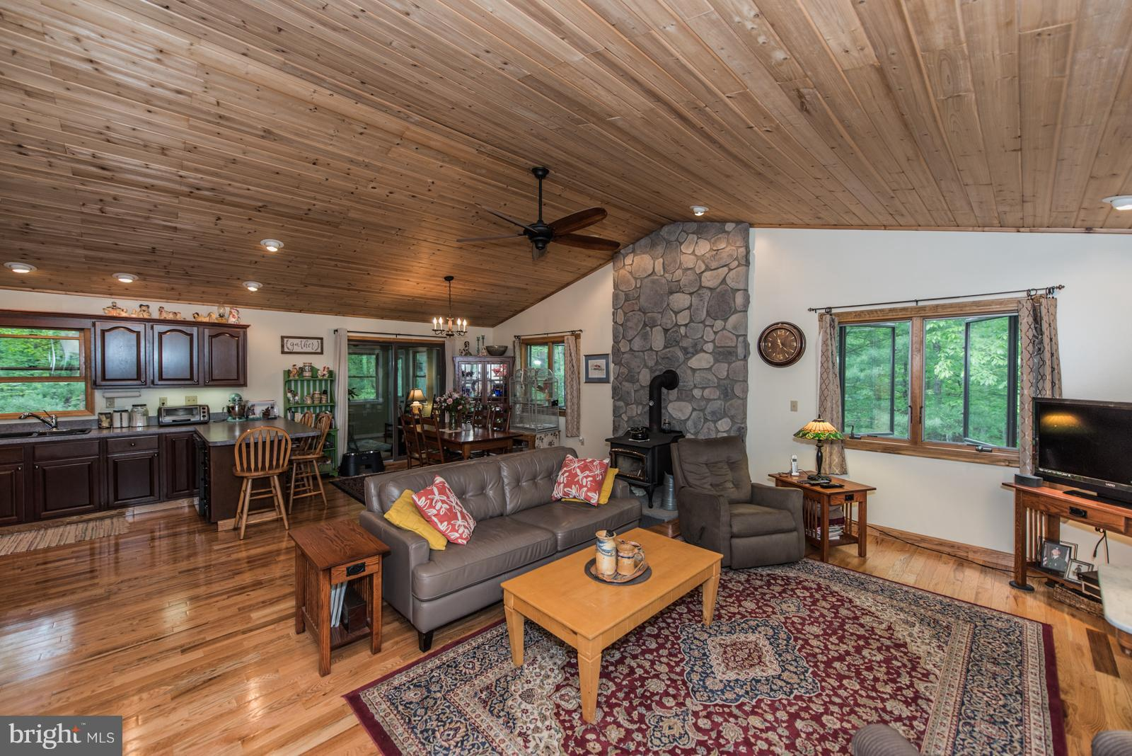 Cedar sided home on a wooded 5.78 acre lot, Short distance to the common area on the Cacapon River.  Tongue and Groove ceiling in kitchen, living and dining areas. 3 bedrooms upstairs, 2 extra rooms downstairs, finished basement w/ barn wood ceiling. The covered front porch welcomes you into the house.  Nice sun room off the dinning room. This house offers:  2018 hot water heater, 2018 heat pump, 2017 12x26 shed, 2017 3 season room, 2017 chimney cap installed, 2017 gutter guards, 2016 new fencing, 2016 whole house generator w/ 2 year mainenance agreement which can be extended, 2016 new kitchen appliances including refrigerator, propane stove and dishwasher.  A must see when looking for a well maintained house close to the Cacapon River.  Home Warranty Included.