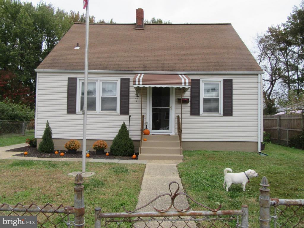 WILL PAY $5,000 OF BUYERS CLOSING COST WITH ACCEPTA BLE CONTRACT!..4 BR or 3 BR and a Dining Room.  2 full GORGEOUS   BATHROOMS!Completely fenced in yard, backs up to woods!  Natural Hardwood Floors/ 1st  level.  TAKE A PEAK AT THE POOL!  THINK  SUMMER & ENJOY THE PARTY HOUSE!The party house comes complete with a propane stove, microwave, refrigerator & a window air unit.  Pull down stairs to a huge upstairs!   A shed 8 x 16 for all of the pool equipment.   Tons of storage on the 2nd level of main house.  This home shows beautifully!  Amazing  opportunity/ great convenient location!