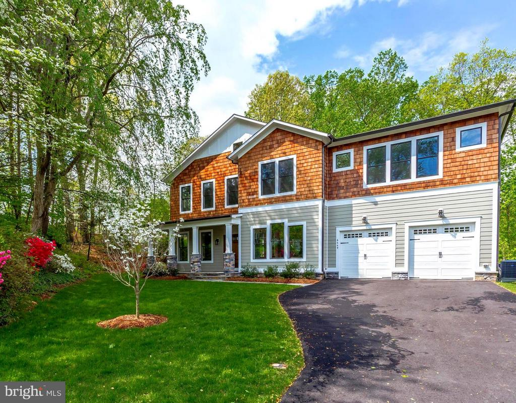 Open house canceled for 3/3.  Custom new stunning Luxury home built by award winning Tri-Crest Homes.   Quiet Cul-de-sac, Surrounded by Parkland.  Open floor plan, Walls of windows, Great for entertaining!  Nature Lovers Dream. Eat-in kitchen & Family Rm opens to a custom Azek deck overlooking forest.   Marble Master Bath! Spacious Walk-Out Lower level features Theatre, Bedrm Suite, Lrg Rec Room.