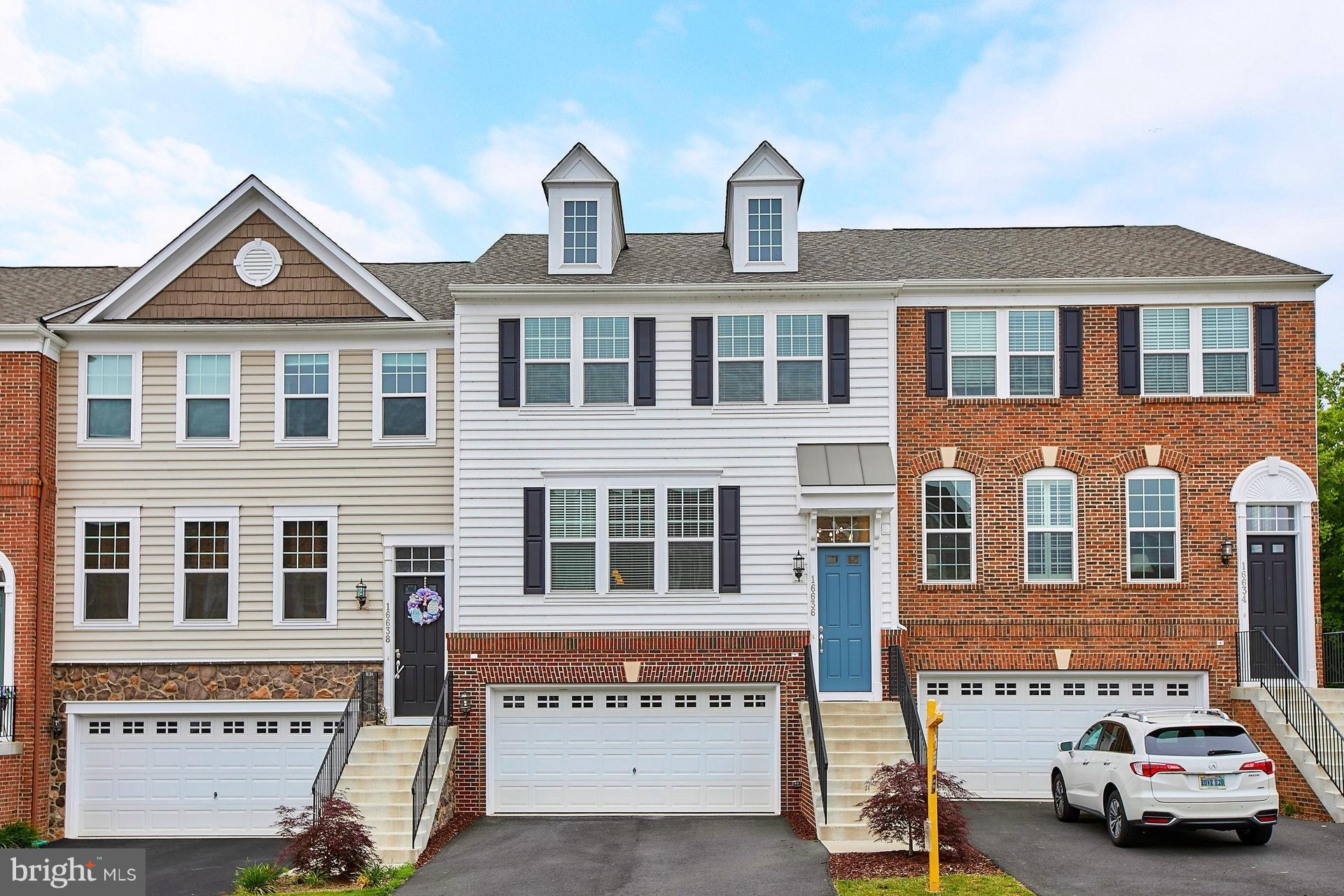 """GORGEOUS 2 YEAR YOUNG TOWNHOUSE W/2CAR GAR*PREM LOT, VERY PRIVATE W/BEAUTIFUL VIEW OF TREES*TWO STORY FOYER*HARDWWOOD FLOORS ON MAIN LEVEL*LIVING ROOM W/GAS FIREPLACE*GOURMET KITCHEN W/42"""" MAPLE CABINETRY, GRANITE COUNTERS ,UPGRADED STAINLESS STEEL APPLIANCESS (TO INCL GAS COOKTOP, BUILT-IN DBL OVEN, REFRIGERATOR W/ICE MAKER & WATER DISPENSER, DISHWASHER), LARGE CENTER ISLAND W/PENDANT LIGHTS*WALK-IN PANTRY*SEPARATE DINING  RM W/DOOR TO DECK*SPACIOUS MASTER BEDROOM SUITE W/WALK-IN CLOSET & LUXURY BATH   W/TUB & SEPARATE SHOWER, DOUBLE VANITY W/GRANITE COUNTERS, UPGRADED CERAMIC TILE, WATER CLOSET*UPPER LVL LAUNDRY*FINISHED  WALKOUT LOWER LEVEL W/LARGE RECREATION ROOM & FULL BATH ROOM*GREAT COMMUTE W/EASY ACCESS TO ROUTES 1, 95 AND TWO VIRGINIA RAILWAY EXPRESS (VRE) STATIONS,  A COMMUTER BUS (PRTC) THAT TAKES RIDERS DIRECTLY TO WASHINGTON, DC, PENTAGON & MORE LOCATIONS*CLOSE TO QUANTICO, FORT BELVOIR, RESTAURANTS, SHOPPING AT POTOMAC MILLS MALL AND POTOMAC TOWN CENTER*HOA AMENITIES INCLUDE USE OF A CLUB HOUSE, OUTDOOR POOL, TOT LOTS, BASKETBALL COURTS & TENNIS COURTS, TRASH/SNOW REMOVAL AND COMMON AREA MAINTENANCE*ENJOY TRAILS AND WALKWAY ALONG NEABSCO & POWELLS CREEKS ADJACENT TO THE POTOMAC RIVER & LEESYLVANIA STATE PARK!"""