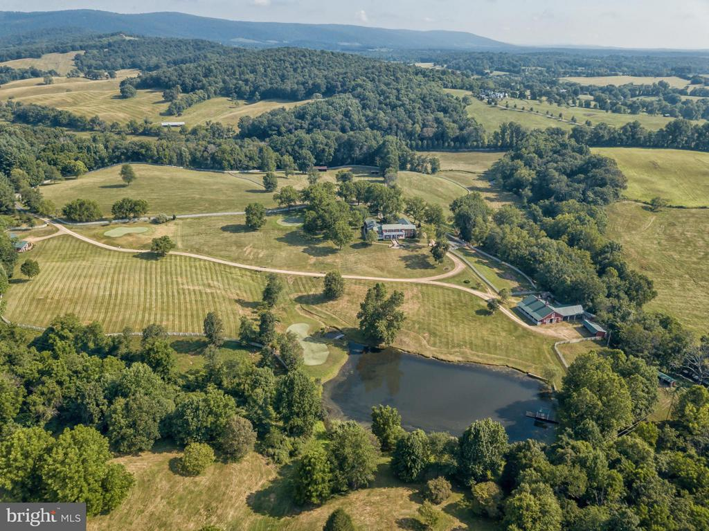 A bespoke 50 acre farm in Delaplane with exquisite home and manicured grounds. A gorgeous Federal style w/ spacious rooms, , gourmet kitchen, 4BR, 3FB, 2HBA, 9 fireplaces, master-suite w/ separate sitting room, two balconies, an interior courtyard, 3 hole golf course, 4 stable barn, chicken coups, numerous outbuildings, & caretakers house. Perfect for full time living or a second home. AS IS Sale.