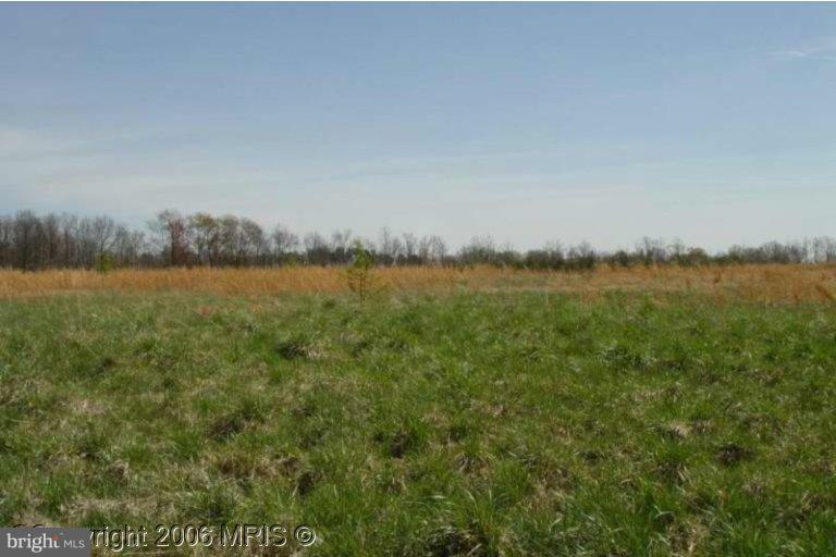 2.5 AC ZONED A-1 W/INCOME PRODUCING RESIDENTIAL. 16.77 AC ZONED AGRICULTRAL W/APPROX 10 AC LAKE. 22 AC ZONED FOR HEAVY INDUSTRIAL USE, IMPROVED W/A 3,000 SQ FT GARAGE REPAIR SHOP.