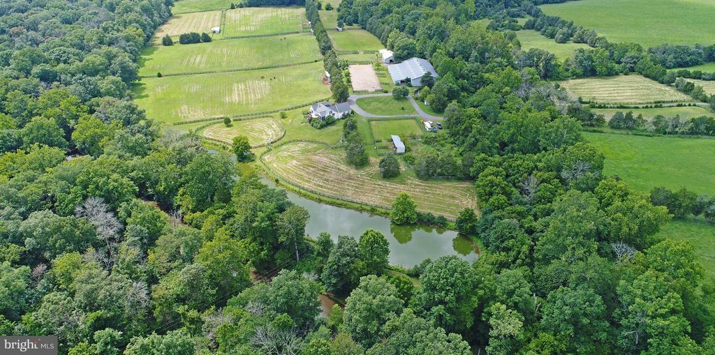 21+ ac. Prestigious horse training/breeding facility-   #1  Barn-Morton  Built-12  stalls total- Indoor Riding Arena 77 x 135 -Hot Water Wash Stall- Heated feed-tack room- 1 bd, 1 bath Apartment   #2 Barn- 8 Stalls with Overhead Hay Storage  #3 Barn- Breeding Shed  with storage area-  Run-ins-  Creek access-  Oak  Board Fencing- Pastures Numerous Run-In Sheds -Private setting adjacent to Manassas Battlefield with access Trails to park.   Beautiful potential homesite-build your new home.- 4 bedroom alternative system required. .Location!-Easy access to Rt 234-29-15-50 & I66   Property in Land Use-Seller no responsible for roll back taxes.  21+/- Acres to be divided (in the process) from 31 Acre Parcel.   Easy access to Rt 234-15-50-29 and I66-close to amenities and shopping while private and secluded.