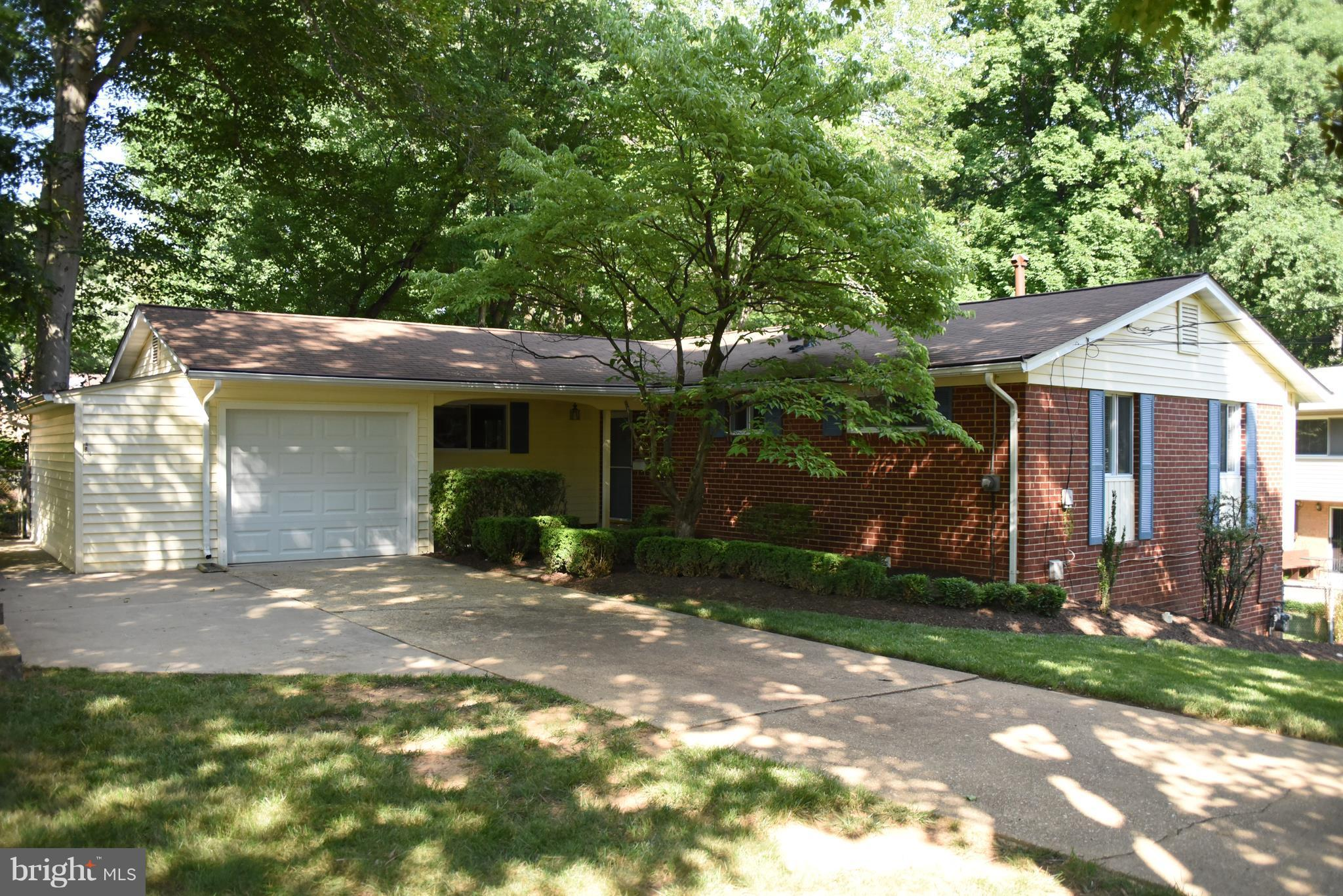 Fabulous 4 Bedroom Home. Remodeled Eat-in Kitchen, Remodeled Baths, New Roof, New Furnace.  Large Screen Porch. Hardwood Floors Throughout. Replacement Windows. Oversized Deck. Oversized Garage. Gorgeous Lot Backing to Parkland and Creek. Close to Metrobus, VRE, Braddock Rd, I-495.