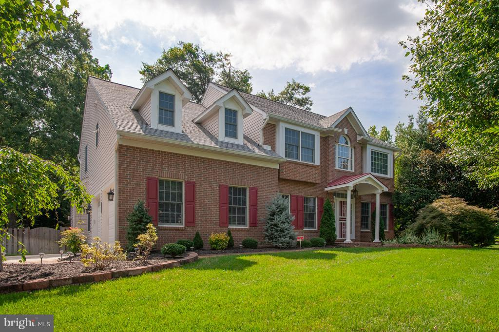 Fantastic SFH on a .3 ac lot boasts over 4,000sf & features 2-car gar w/6-car driveway, fresh paint, new carpet, hardwoods, upgraded BAs w/granite-top vanities, incl. the spa-inspired MBA w/heated floors. Upgraded eat-in KIT w/stainless, granite, ctr island & 42in cabs. Lovely screened porch overlooking the flat bkyd. Walk-up LL w/rec rm & generator. Great shed in the bkyd. Near 95!