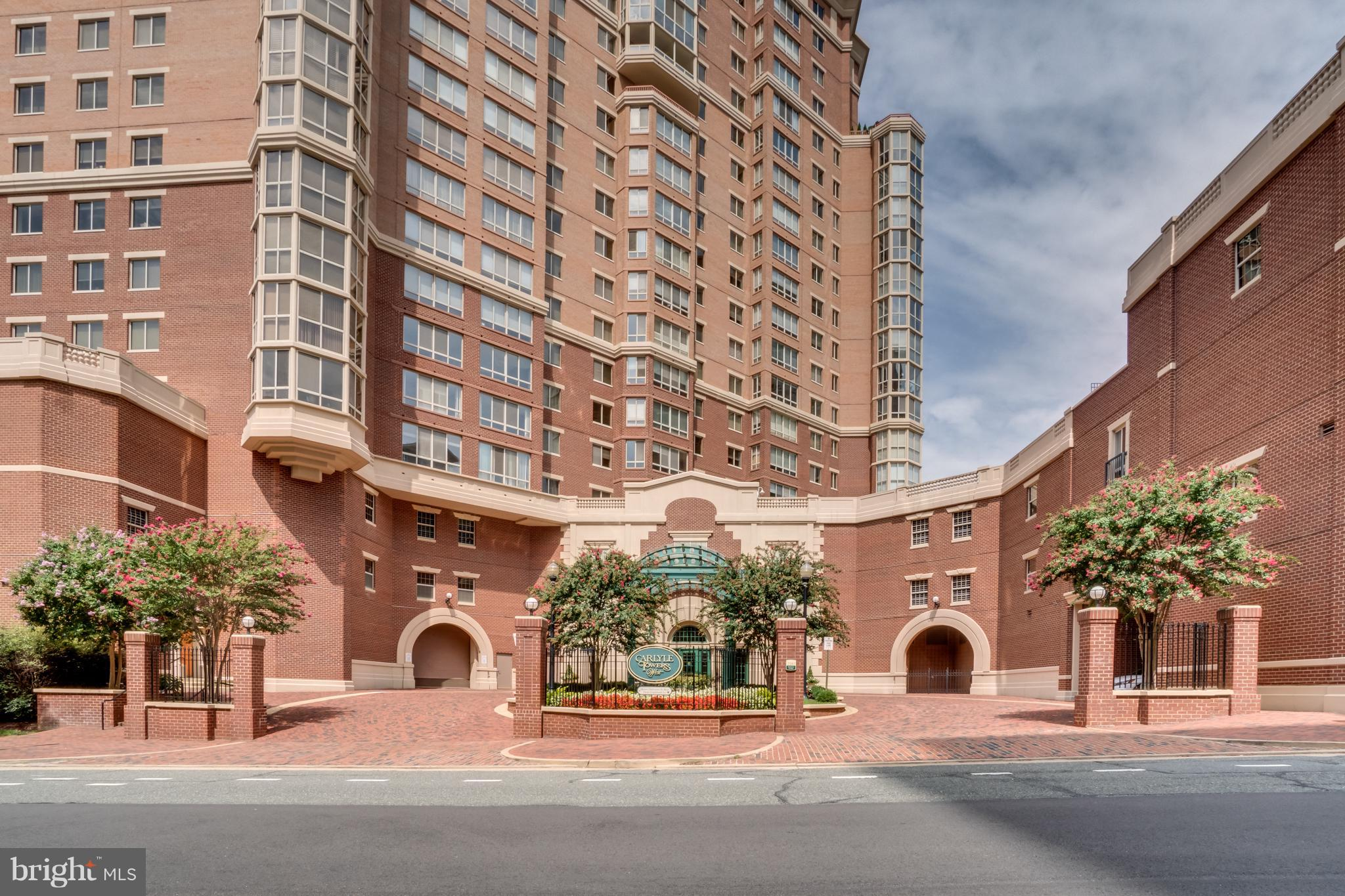 OPEN HOUSE SUNDAY 2/17 1-4PM. You're going to love this property! Carlyle Tower Condo - Luxury, Location and a lifestyle in Alexandria! Bright and open floor plan w/ 1,605 sqft of renovated space + an enclosed balcony. Large private MBR suite an updated luxe bath and 4 closets. Updated EIK with SS appliances, Pergo floors, Lg. separate DR, open LR w/ FP and full wall of built-ins opens to the balcony. Hardwoods and carpet. Close to METRO, Whole Foods, Amazon HQ2, & much more!
