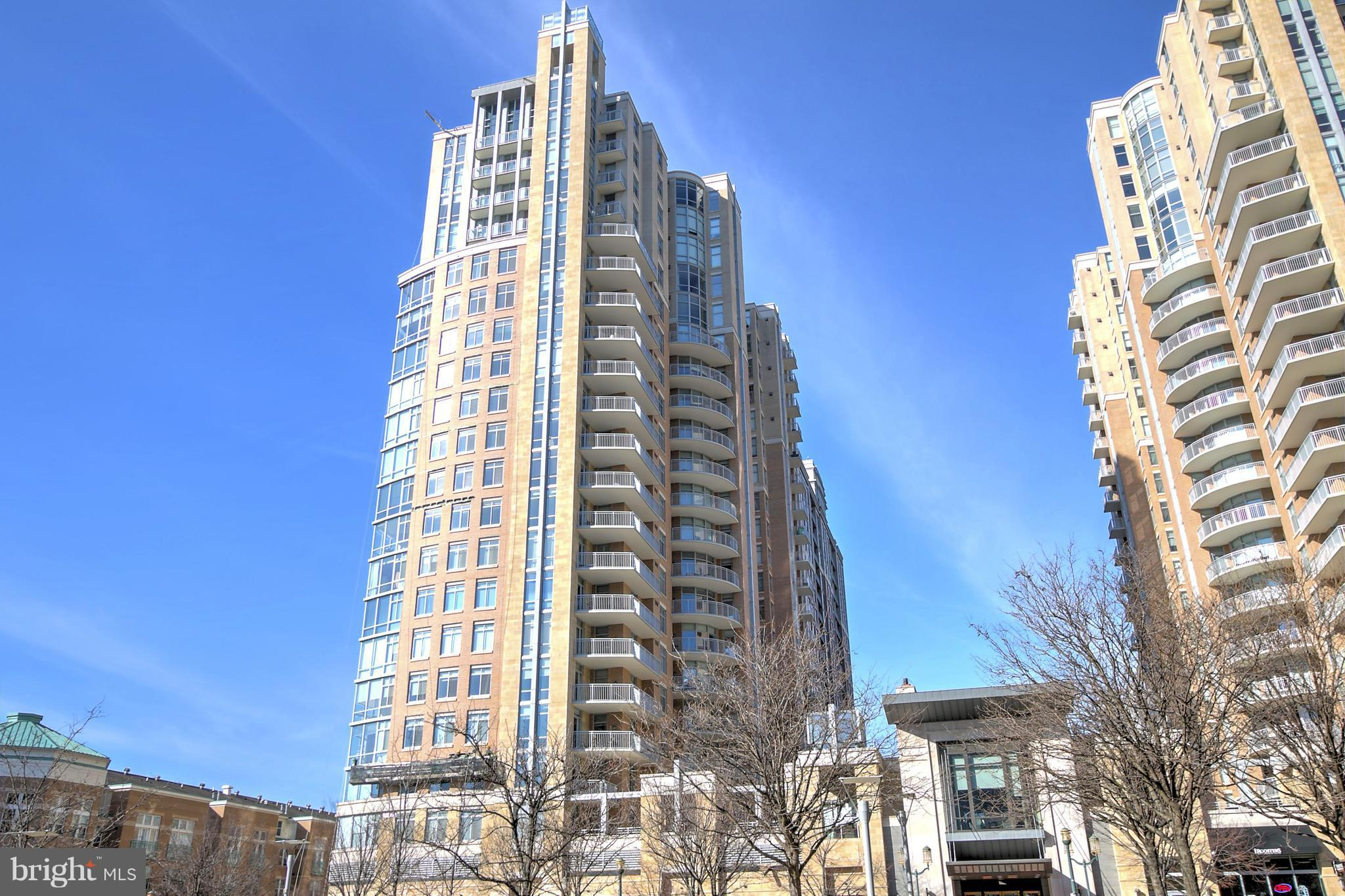 Come see this amazing Penthouse in the West Tower of Midtown! 2 BR+Den and 3 full baths! Over 2000 square feet!  Amazing 18th floor views from large balcony! Original owners have lived here just a month or two each year - it looks like new! Only 5 homes on the 18th floor. Extra tall ceilings! 2 side by side garage spaces by the elevator! Amenity-rich building with movie theater and valet  parking!