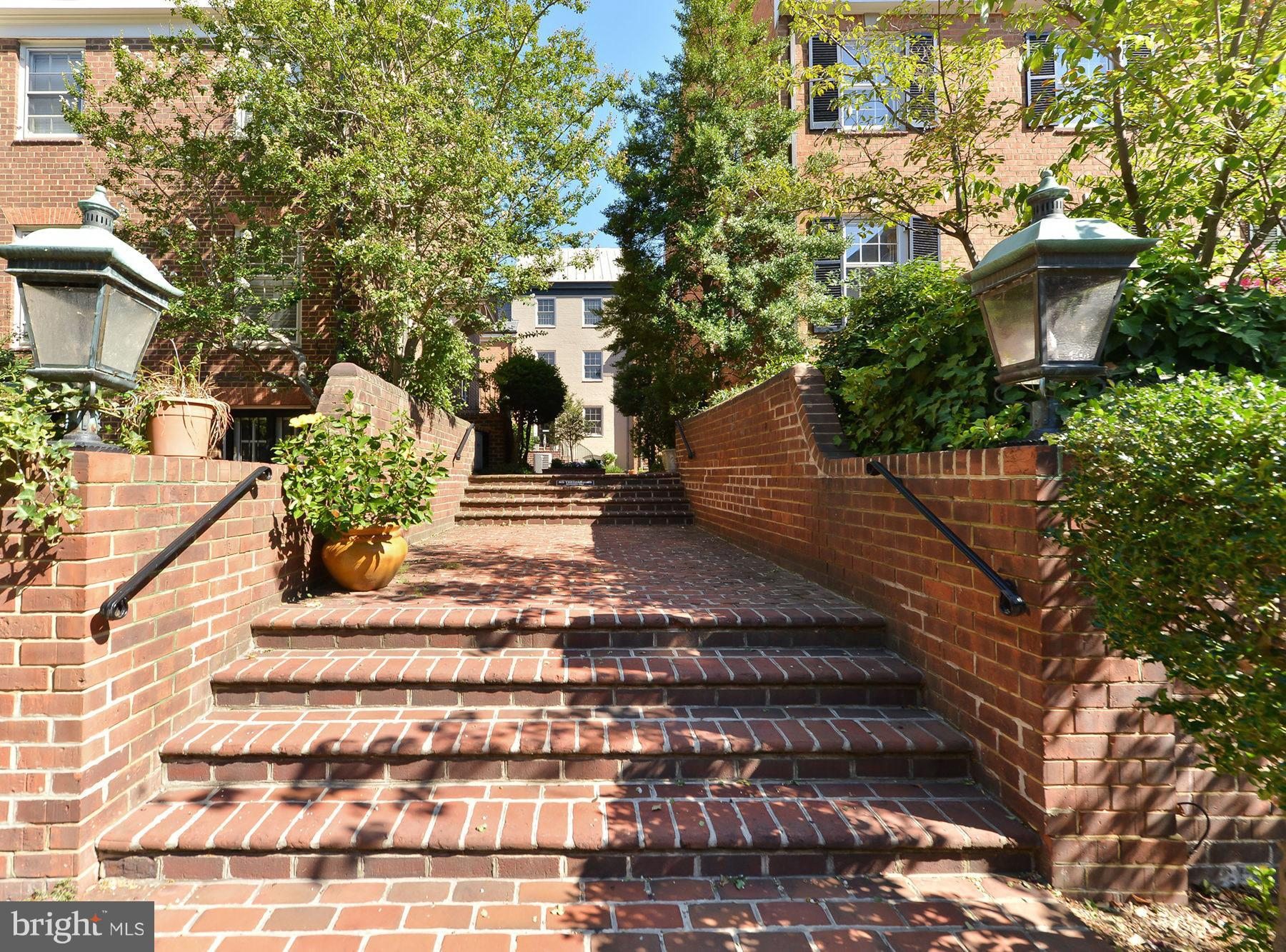 A Private Mews (small enclave of townhomes),this exceptionally bright END UNIT provides 2,970 elegant square feet, upgraded kitchen with Bosch appliances, PARKING #17, two newly lined fireplaces, large walled garden/patio.  Steps to shops, grocery, restaurants and transportation.  Off-street parking!