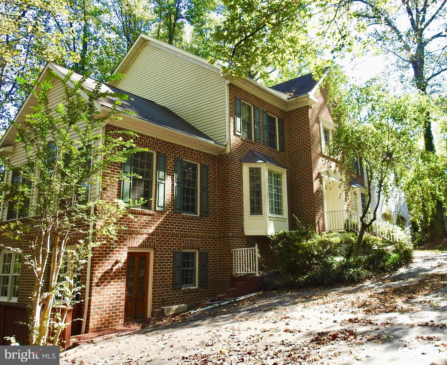 Short term or long term. Furnished or $6,900 unfurnished. One of a kind private estate retreat on 1.14 acres in the heart of McLean and only a 35-minute drive to Amazon HQ in the morning and Afternoon rush hour. The Hawthorne Valley Lodge is a 5 Bedroom, 4.5 Bath 6,500 SqFt home located within walking distance to Metro bus, restaurants, Fitness centers, spas and grocery. Surrounded by 6 acres of private land and 3 acres of parkland, the home is only a 15-20 minute drive to DC. It features extensive outdoor living space and remodeled interior design to meet all your needs. The extensive exterior living space includes a 1,600 SqFt 3 level deck nestled among the trees that overlook the Pimmit Run Creek with natural gas grilling area and portable fire pit. The lower level Flagstone patio and turf area feature a flagstone fireplace, 10 person Hot tub, Golf chipping practice area trampoline and waking steps to Pimmit Run Trail system. The 10 acre Hawthorne Valley is known for fantastic wildlife watching, hiking & Biking trails and fishing in the Pimmit Run. The 3 level interior of the home comprises of the main level with a 2 story entry foyer flanked by a formal living room with Piano sunroom. A full office /library off the foyer and entry into an open space gourmet Kitchen with 6 burner gourmet gas stove, built in Refridge and large island. The kitchen opens to a breakfast nook and family room with a gas stone fireplace and a sliding door opening out to the 3 level deck which includes a Gas grill and fire pit. Off the kitchen and separated by a swinging door is a large formal dining room with seating for 12 with a large window overlooking the Hawthorne Valley. The upper level has 4 large bedrooms and a sitting room off the master bedroom (which could be 5th bedroom). The 3 large upper bedrooms have remodeled Granite bathrooms and the Master suite was completely remodeled in 2018. The remodeled master suite includes a marble Master bath with separate shower and Jacuzzi t