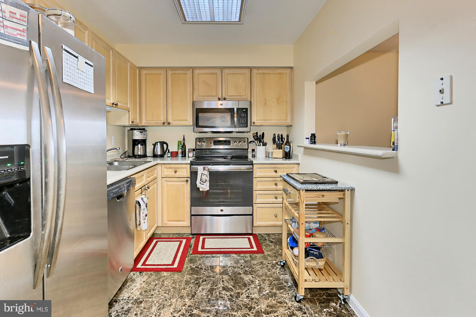 Light & bright open, unique floorplan w/many updates. In 2017: new paint, new BR carpet, newer wood floors in LR/DR. Sunny encl balcony, not incl in 1,145 sqft. Large MBR w/2 closets. MBA has dual vanity, glass encl shwr & sep tub.Sought after South bldg w/quiet view. Walk to 2 metros, Whole Foods,shops,restaurants,movies etc. Enjoy pool,tennis,2 gyms,putting green&24-hr security. 1 garage&storage