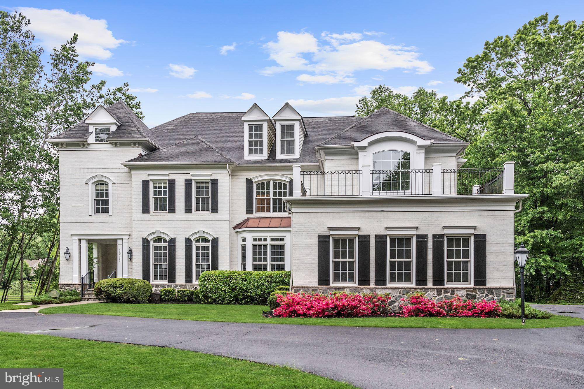 Stunning 5BR 5.5BA on 1.10 acre! Circular drive to covered porch. Foyer welcomes you w/grand circular staircase  LR w/stone wall & 2 story FR w/stone FP & 3 Palladian windows! Spacious gourmet kitchen w/island, gas FP, icemaker & wine cooler! DR w/Butler's pantry. Lux Mstr w/tray ceil, newly updtd bath & 2 cedar WIC. RR w/FP, fabulous full bar, gorgeous wine cellar & steamroom! Super location!