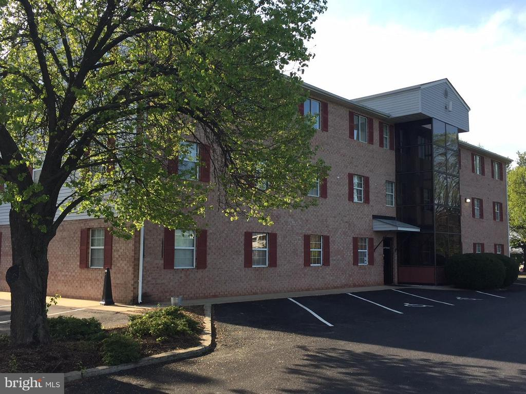 NEW PRICE!  3 Story, multi-tenant, brick front office building containing approx. 10,800 sq. feet. Medical services 1st fl., Accounting/Massage Therapy 2nd fl., Consulting services on 3rd fl.  3 stop glass front elevator, paved parking, alarm, etc. Zoned Res/Light Ind/Com.  24 hr notice required for LA to accompany for tour.