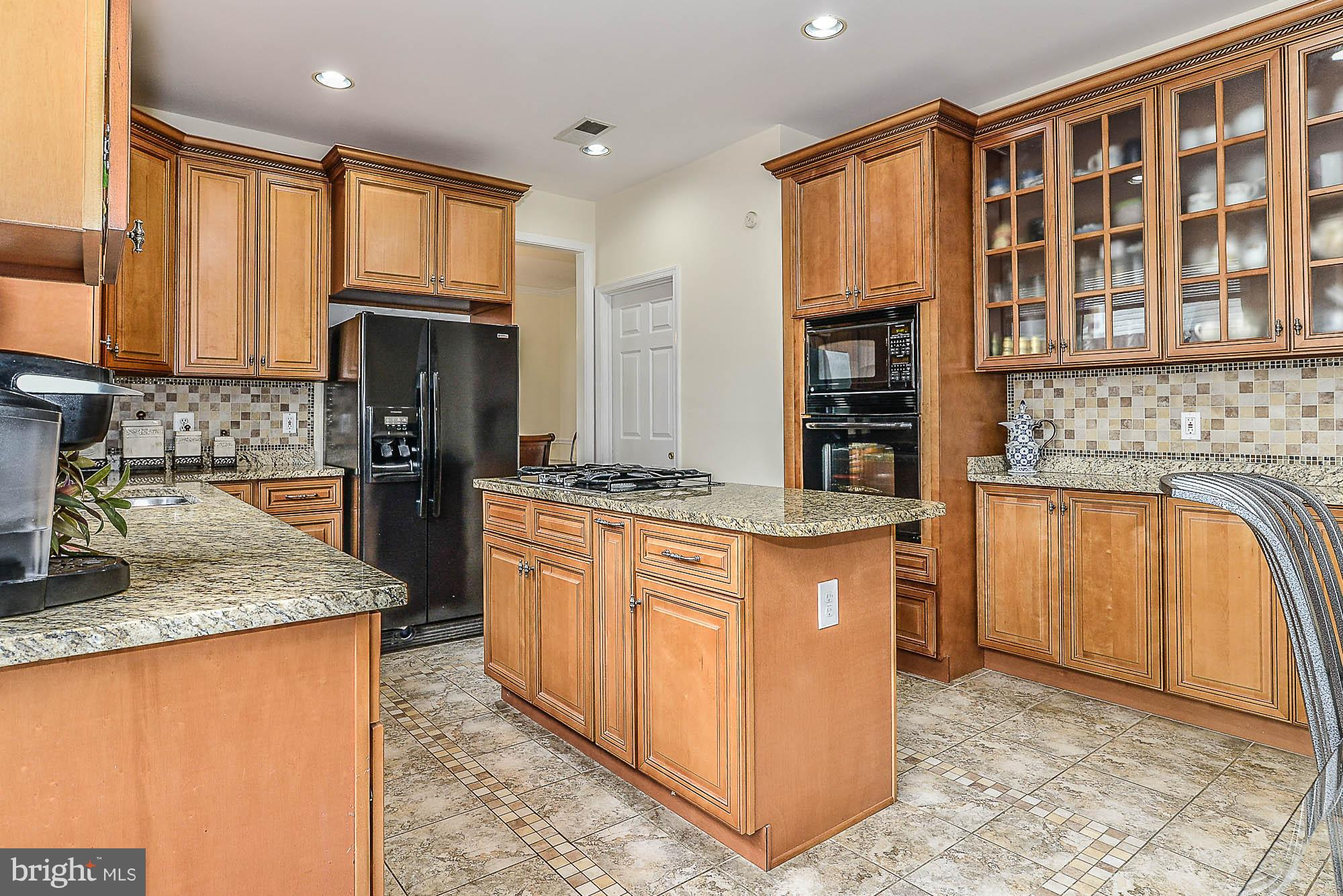 Totally Updated Brick Front Colonial on one of largest lots in neighborhood! New HVAC! Dramatic 2 story foyer & open floorplan. Wood flrs thruout main lvl. Eat-in Kitchen w/granite, upgraded cabs, tile fls & backsplash. Fam Rm w/wood burning FP steps out to large deck! Master w/cathedral ceilings, sitting rm & priv lux bth. Spacious add'l bedrms! Fin LL is perfect for entertaining! Great Location!