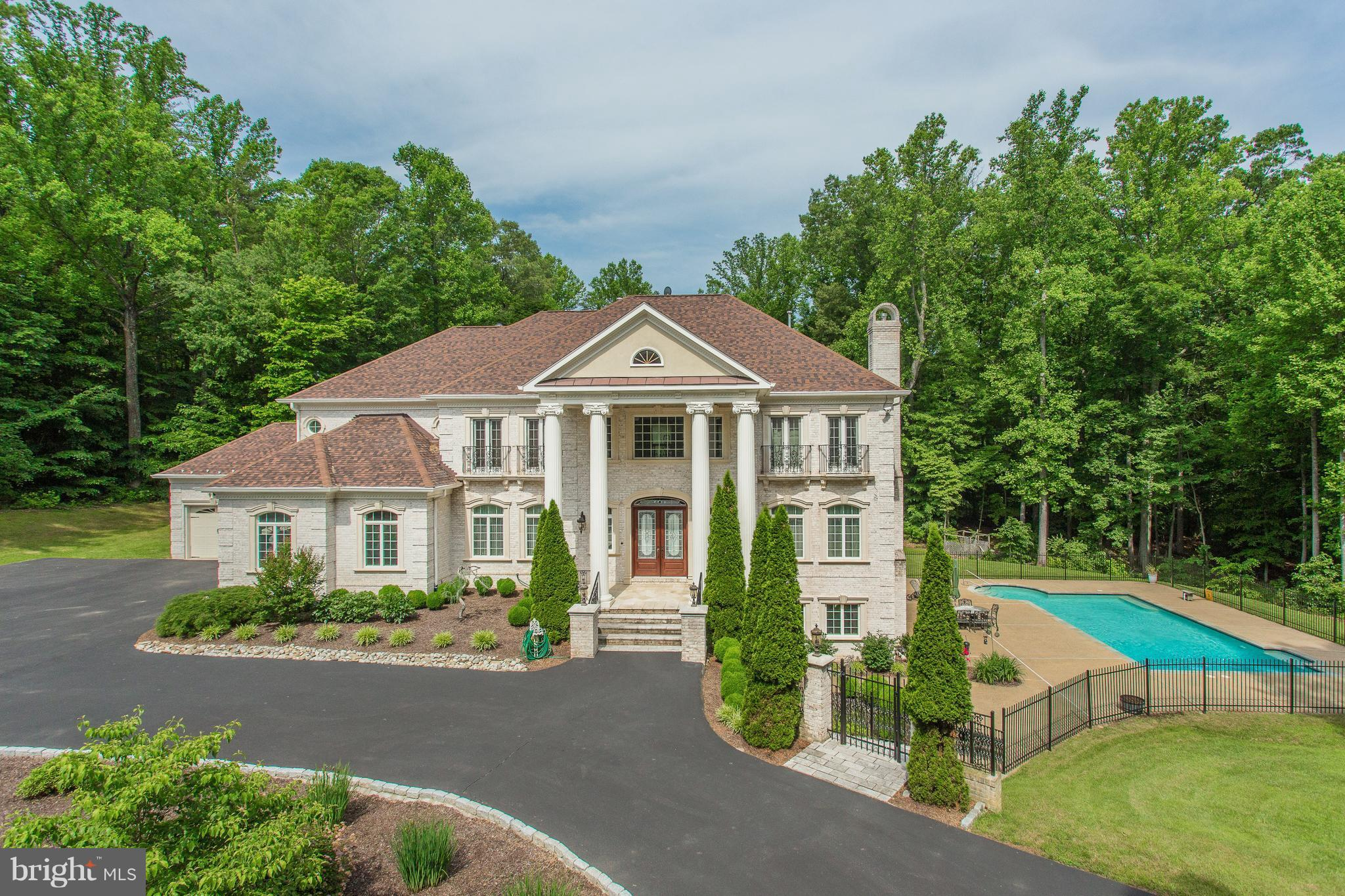 **MUST COME SEE** GORGEOUS private 5AC lot w/9500+total sqft estate of pure perfection! Exquisite details throughout w/ELEVATOR. 2-Story foyer w/curved staircase & formal LR & DR. Chef's caliber dream come true kit. 2-Story FR w/coffered ceil, frpl & view of UL landing. Luxurious master Ste w/frpl, Juliet balcony, 2 WIC & grand BA. Entertaining LL w/wet bar, RR & media rm. Gorgeous pool & 4 car gar.