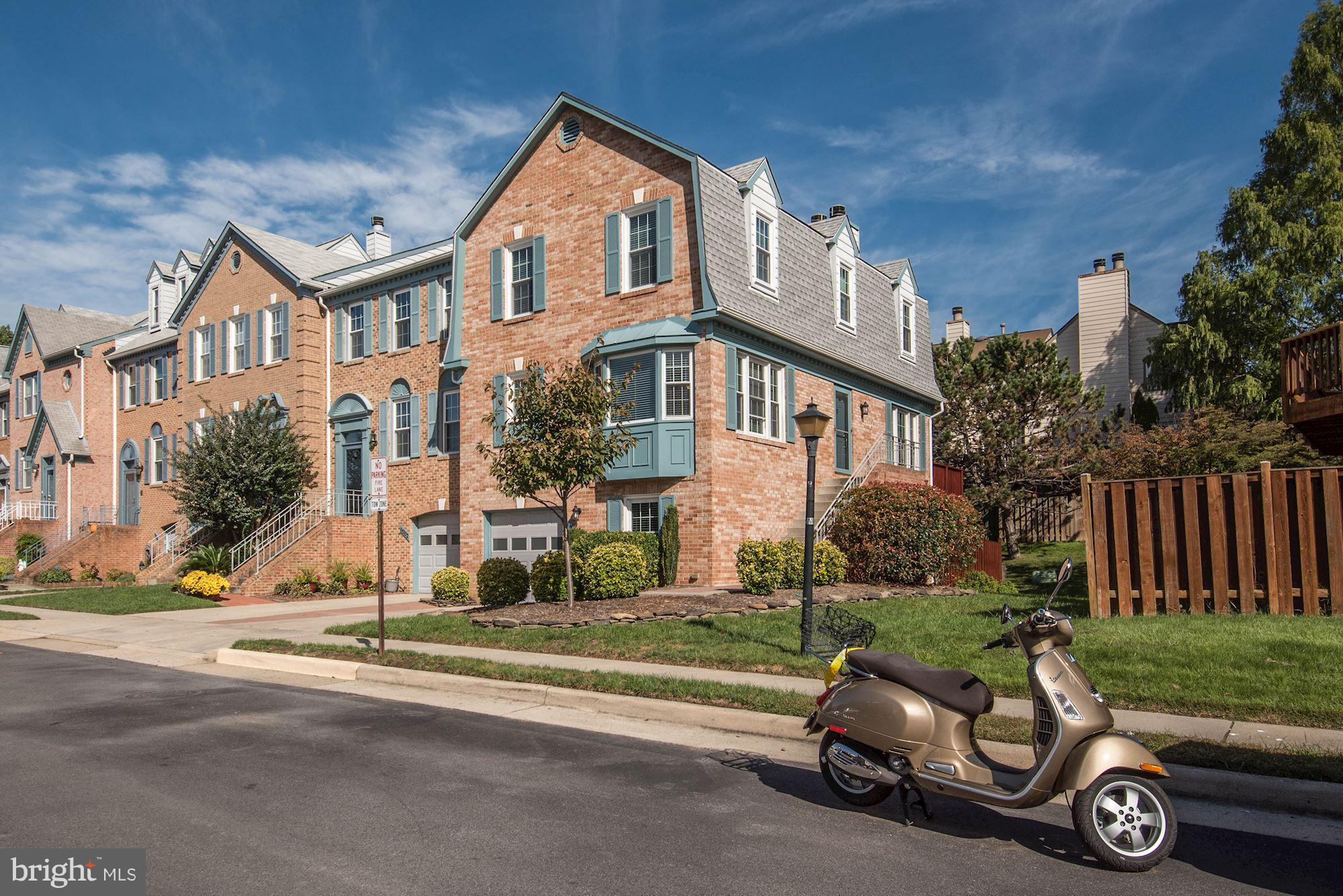 **MAXIMUM CURB APPEAL** Pride of ownership shows in this end-unit garage townhome! Light & bright w/ gleaming hardwood floors+New Windows & Roof! Eat-in kitchen w/ granite tops+stainless appliances+serving bar. Remodeled master suite feat his/her closets+2 sinks+soaking tub+shower for 2. Big deck w/backyard patio perfect for outdoor fun. Cavernous lower level family room w/ sep den/office/playroom