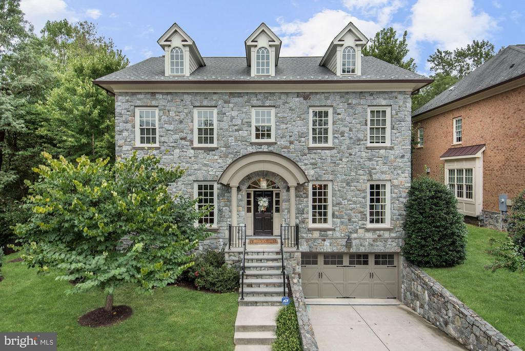 Stately colonial centrally located close to DC, Arlington, & Tysons on Cul-De-Sac. Dark HW floors, detailed moldings, high-end finishes throughout. Gourmet KIT w/ marble-island, 6 burner gas stove opens to the sunny breakfast nook, FAM RM, & butlers pantry. UL w/ 4 BR, master w/ his/ hers WIC, spa bath w/tub & sep shower. LL w/ exercise rm, 5th bed & rec room w/wet bar. 2 car GAR & patio