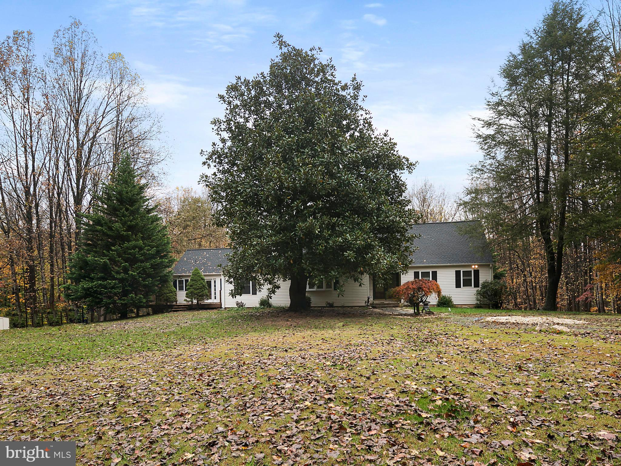 Well-loved 7 bedrooms home on 4 acre land In-law suites with kitchen at fully finished basement Freshly painted spacious living room watching deer in backyard Fireplaces in family room and bedroom New well pump & hot water tank, two heat pumps